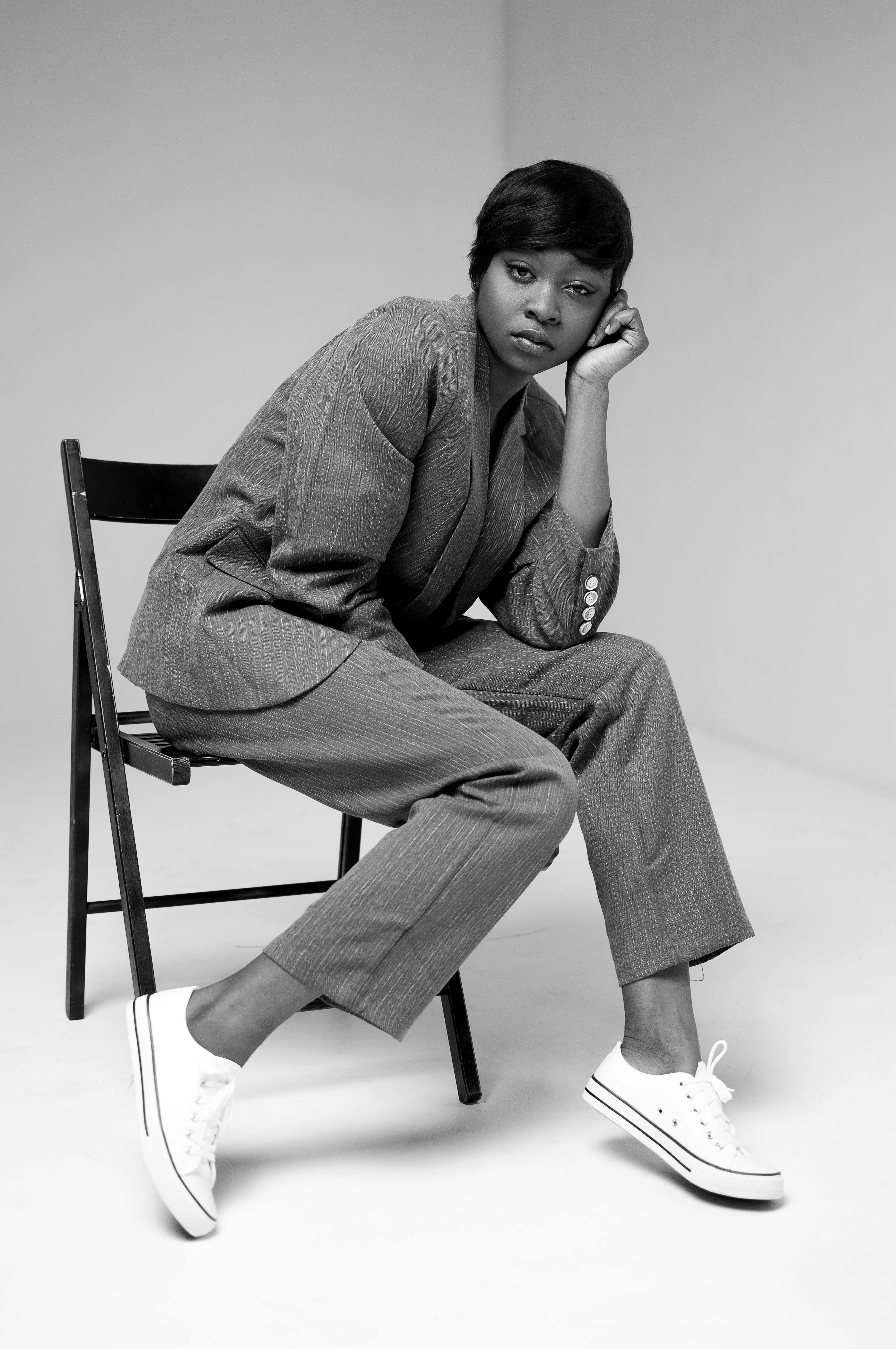 Grayscale Photo of Woman in Formal Suit Sitting on Folding Chair, Beauty model, Sad, Pants, Person, HQ Photo