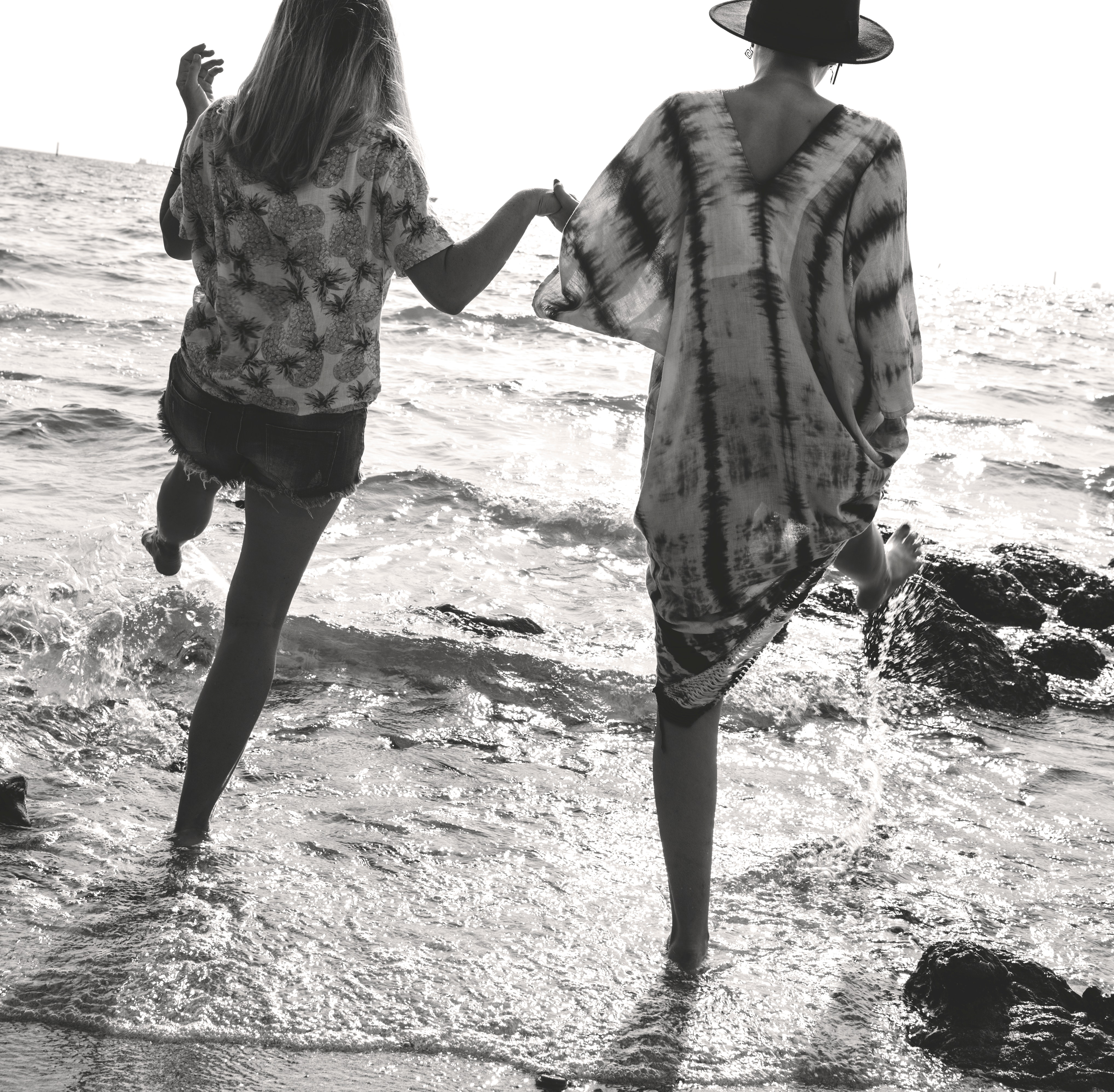 Grayscale Photograph of 2 Women Holding Hands While Walking on Sea Shore, Sunny, Portrait, Recreation, Relaxation, HQ Photo