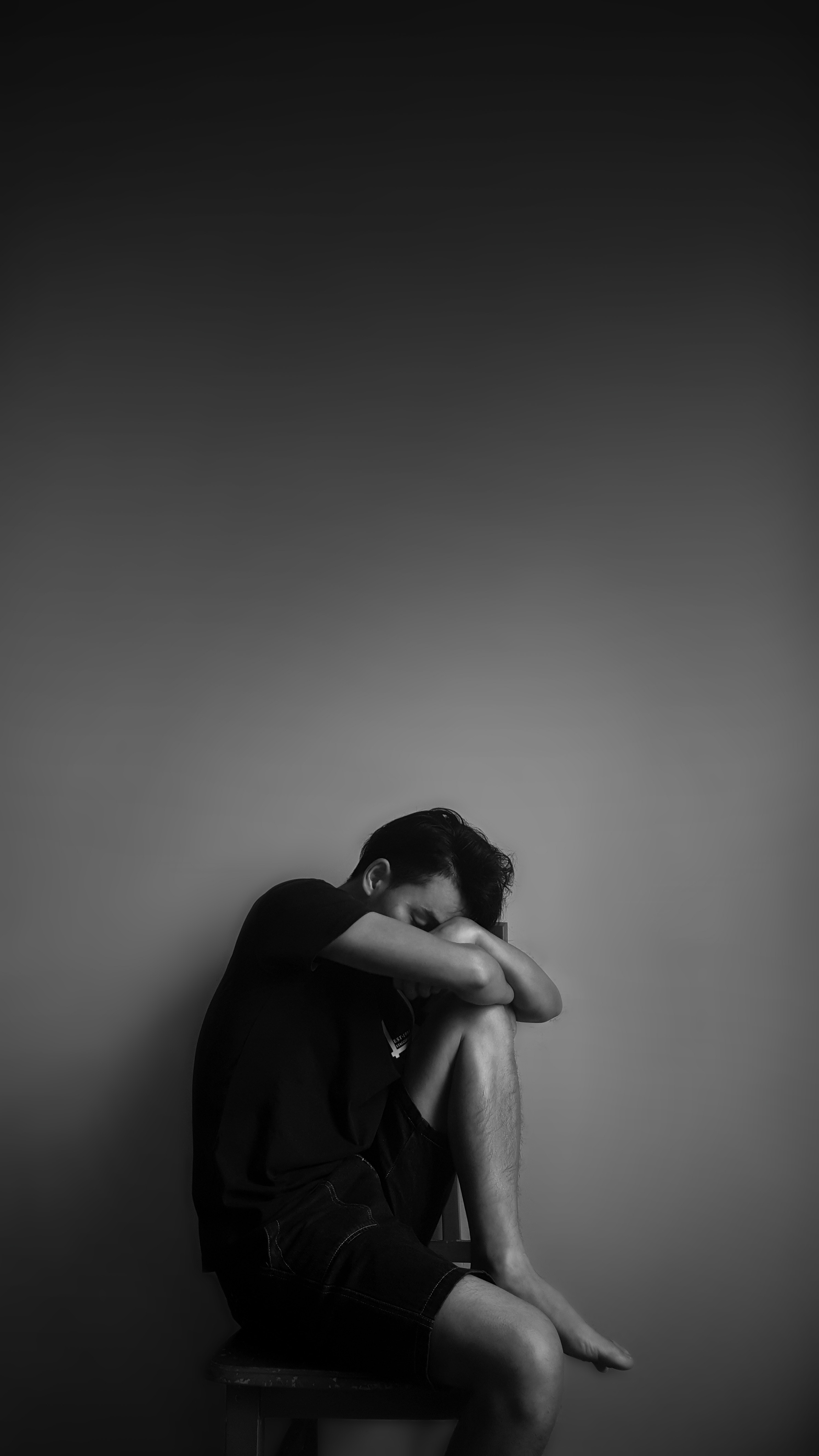 Grayscale Photography of Man Sitting Beside Wall, Adult, Man, Side view, Sad, HQ Photo