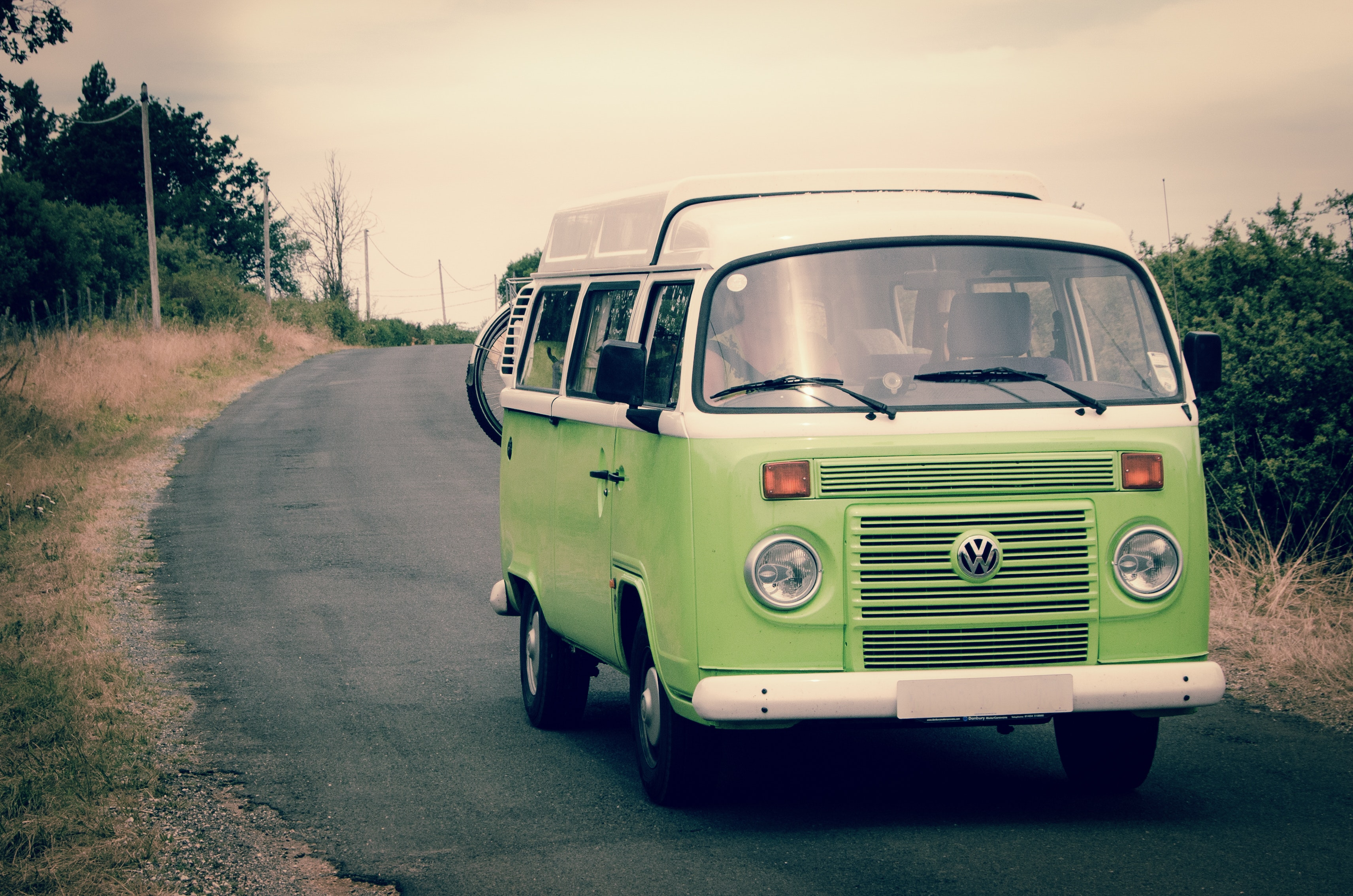 Green and white volkswagen combi photo