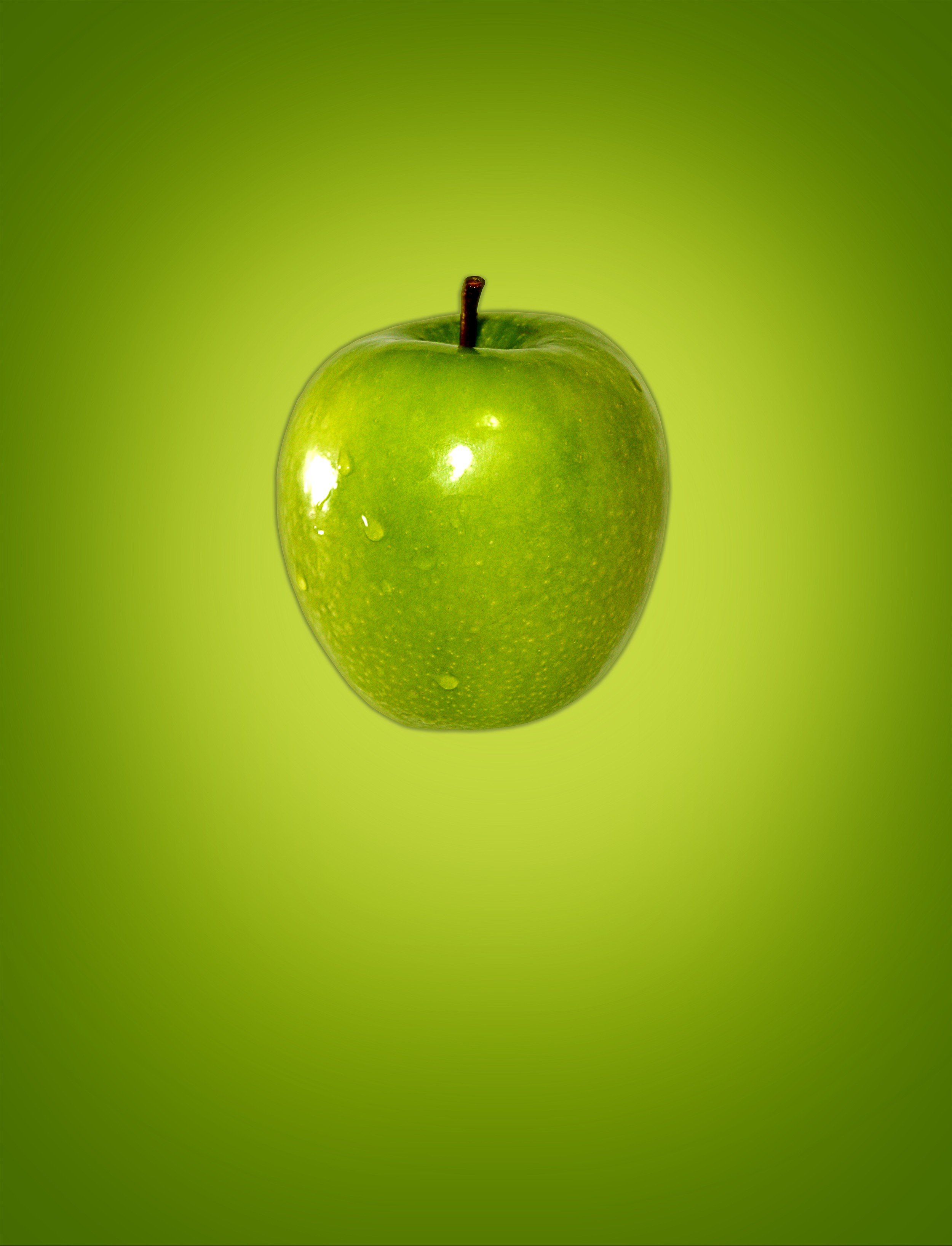 Green (apple) on green (background) photo