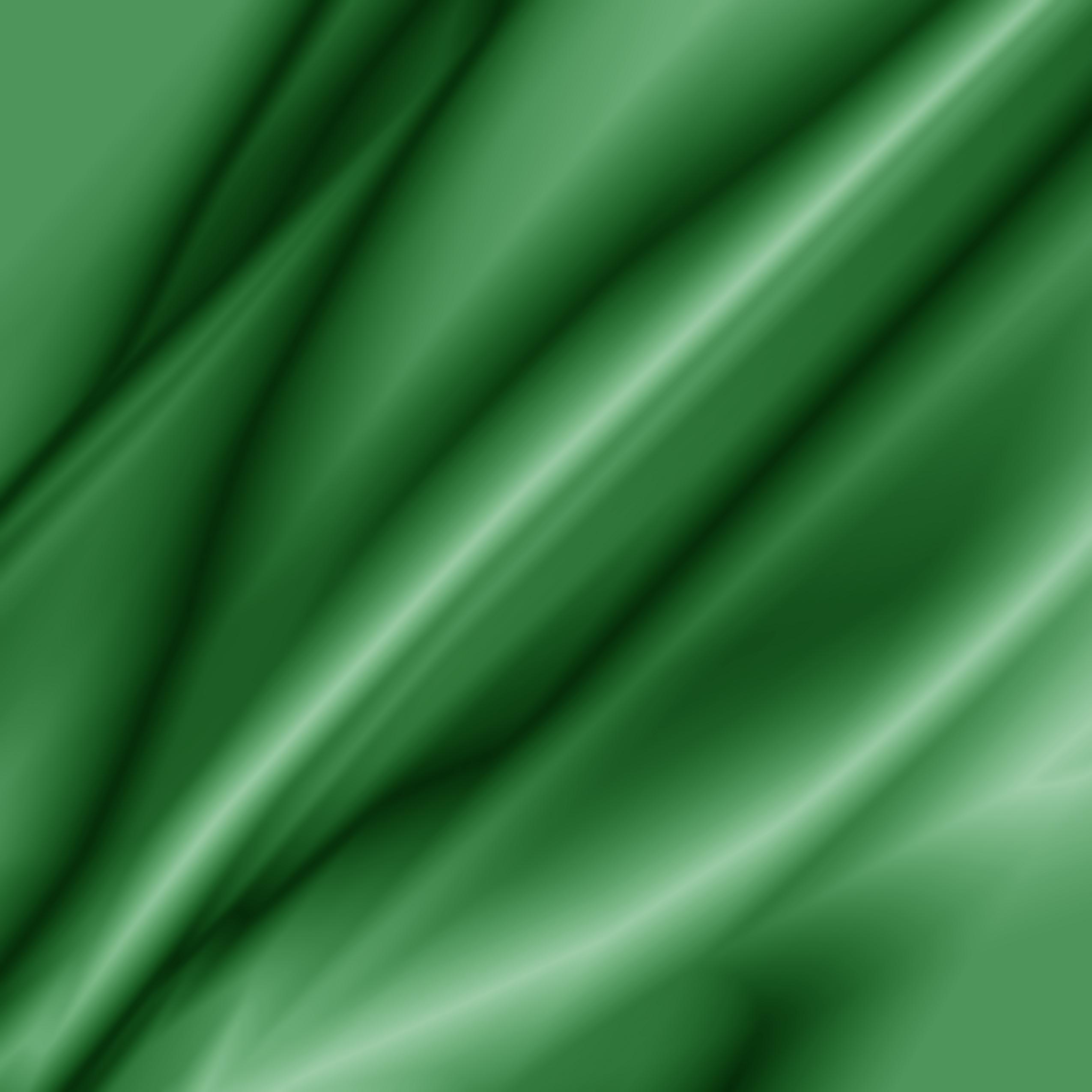 Free photo Green fabric texture shiny sheet silk Non
