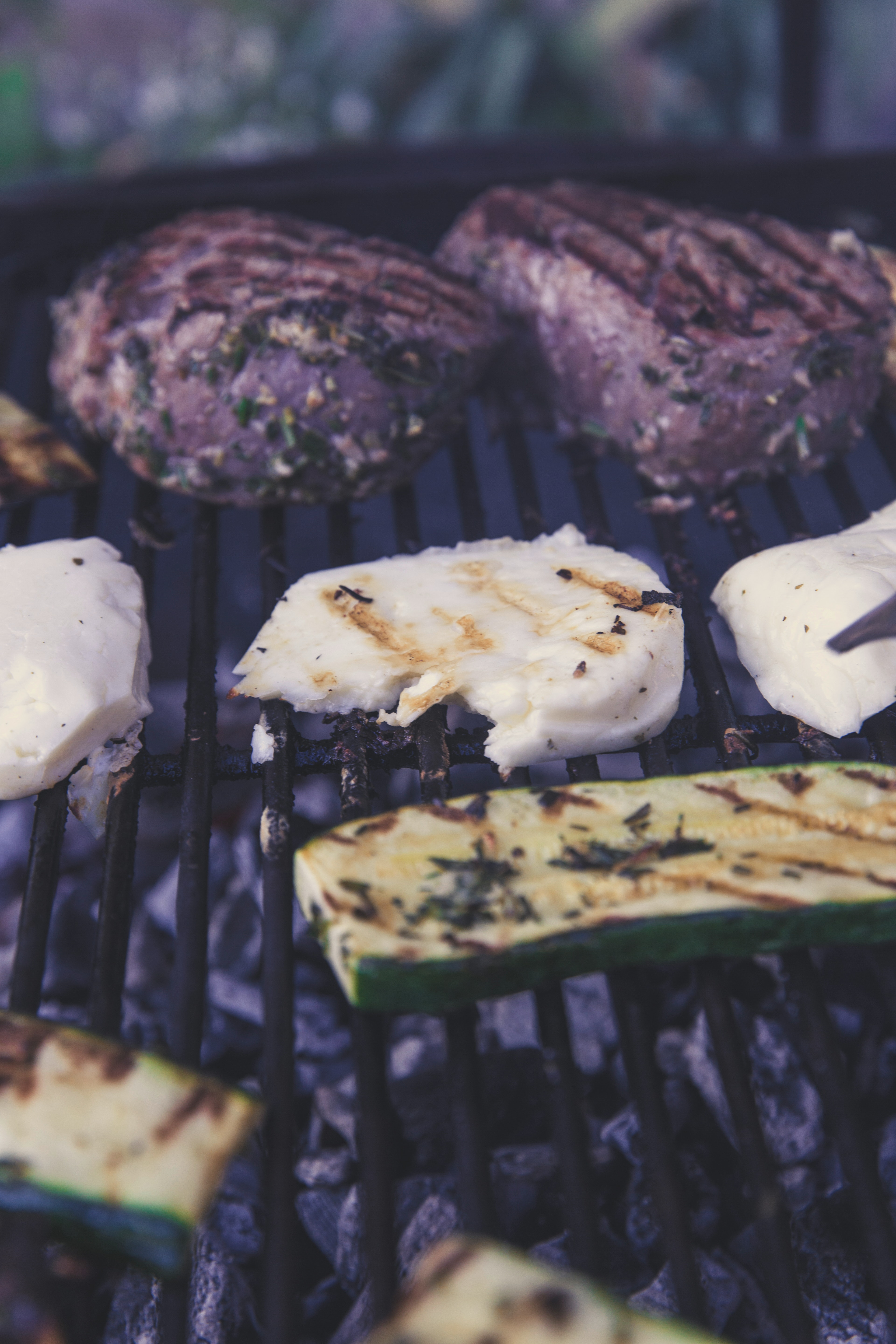 Green grilled sliced cucumber on black grill photo
