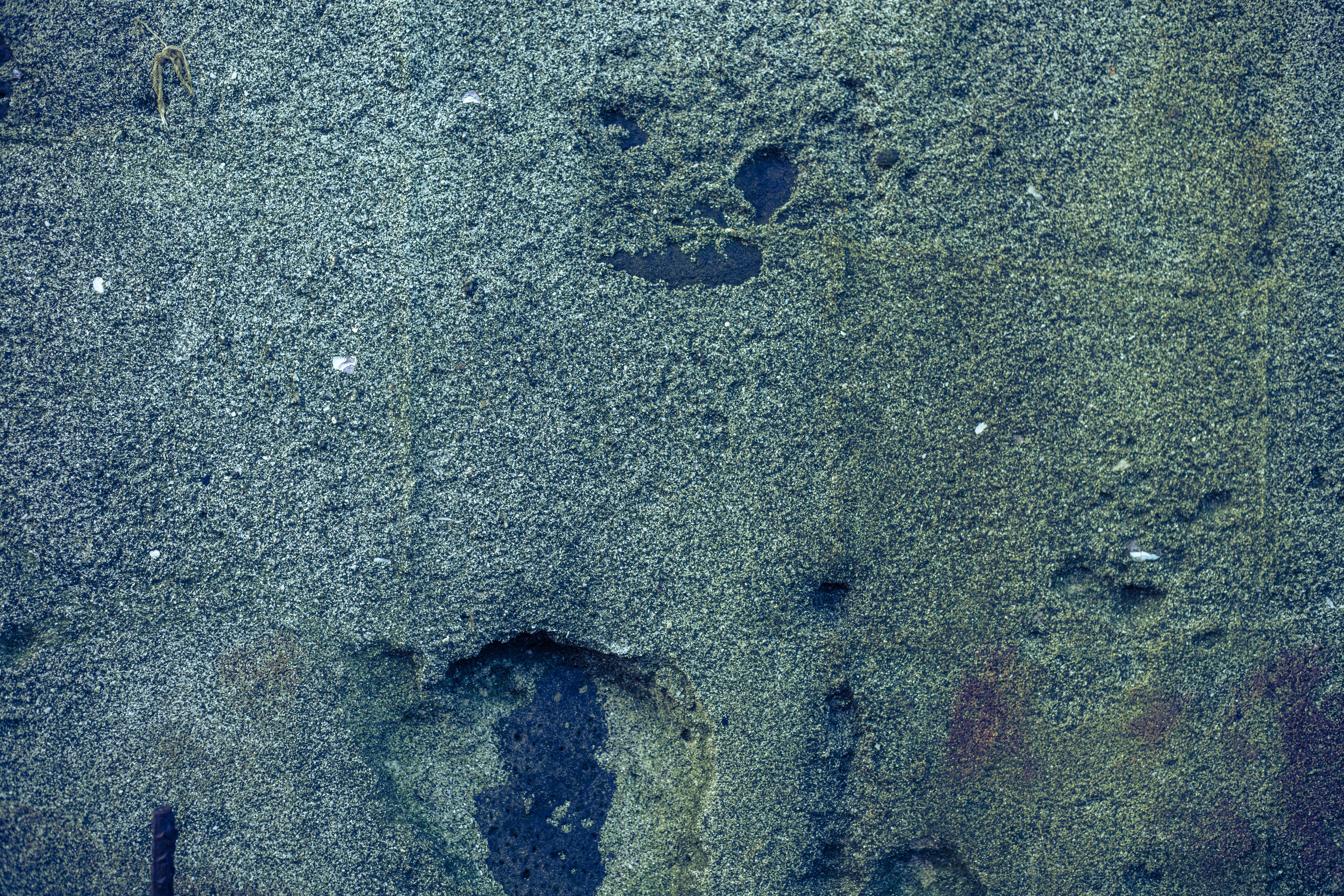 Greenish stone wall texture photo