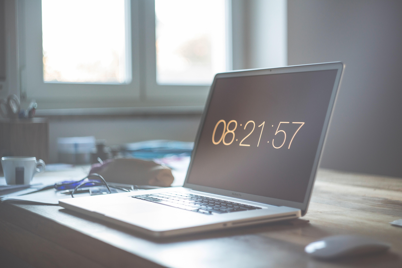 Grey laptop computer set at 08:21:57 photo