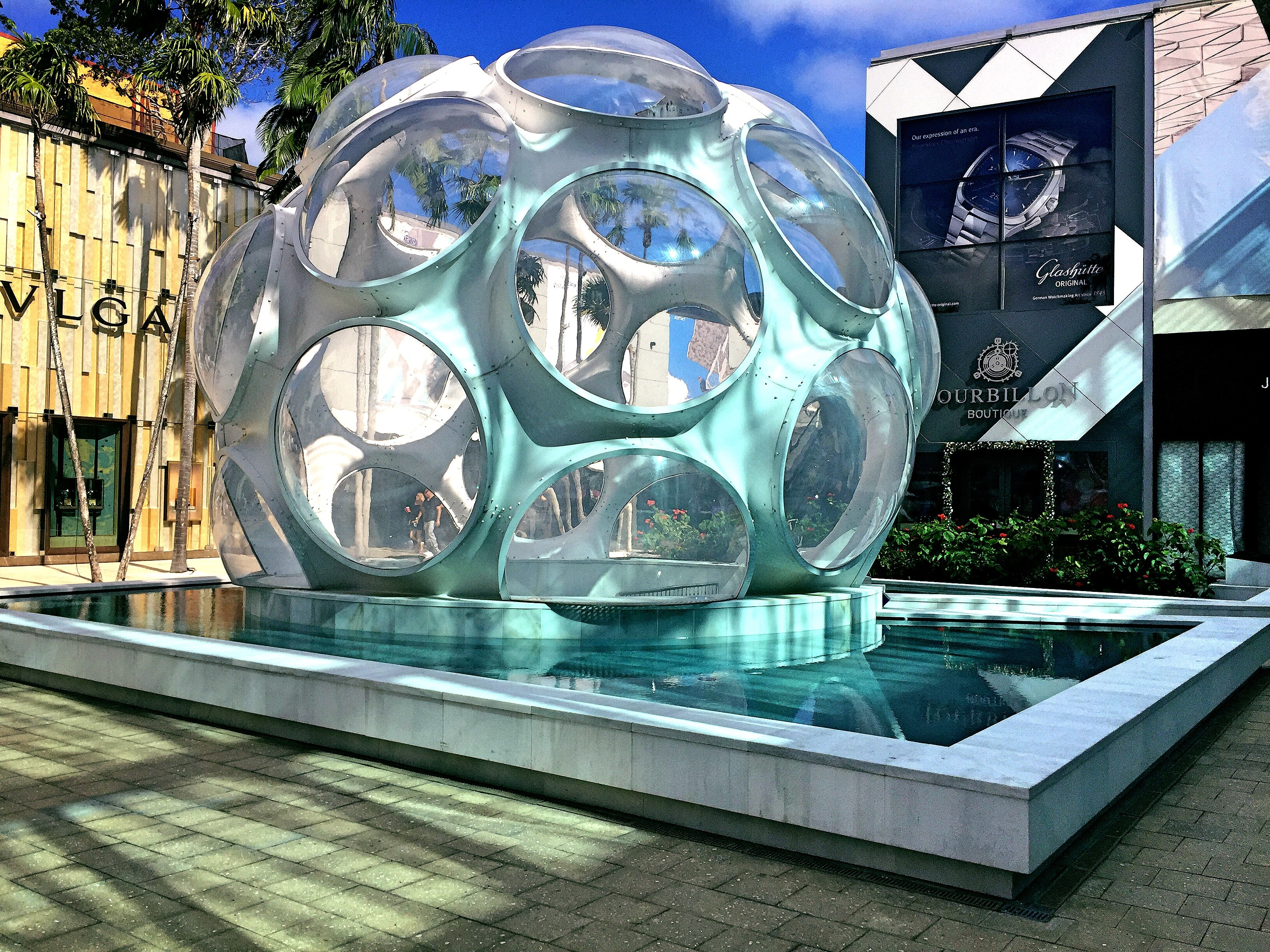 Grey sphere with round holes tourist attraction photo