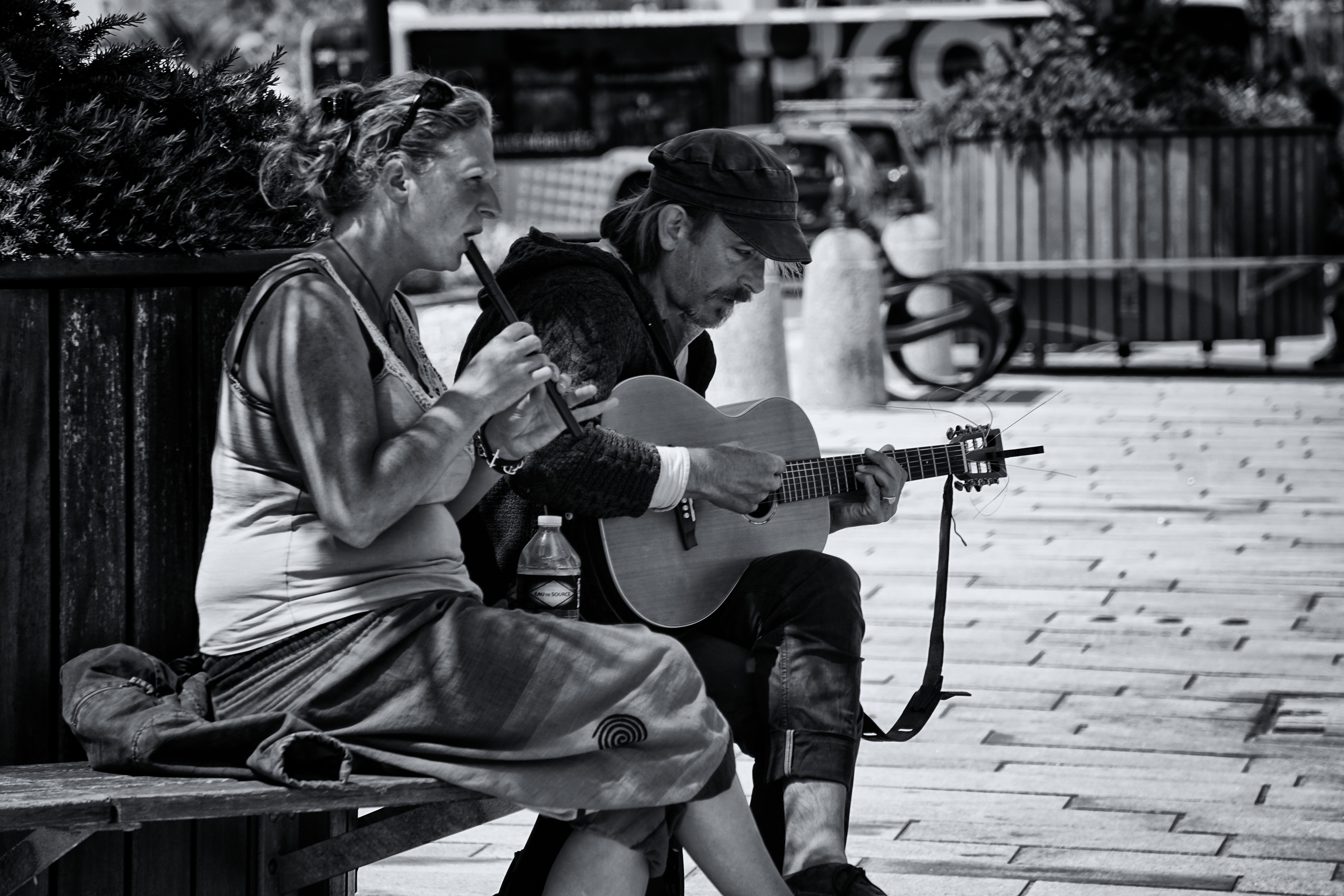 Greyscale Photography of Man and Woman Playing Musical Instruments, Street, People, String instrument, Woman, HQ Photo