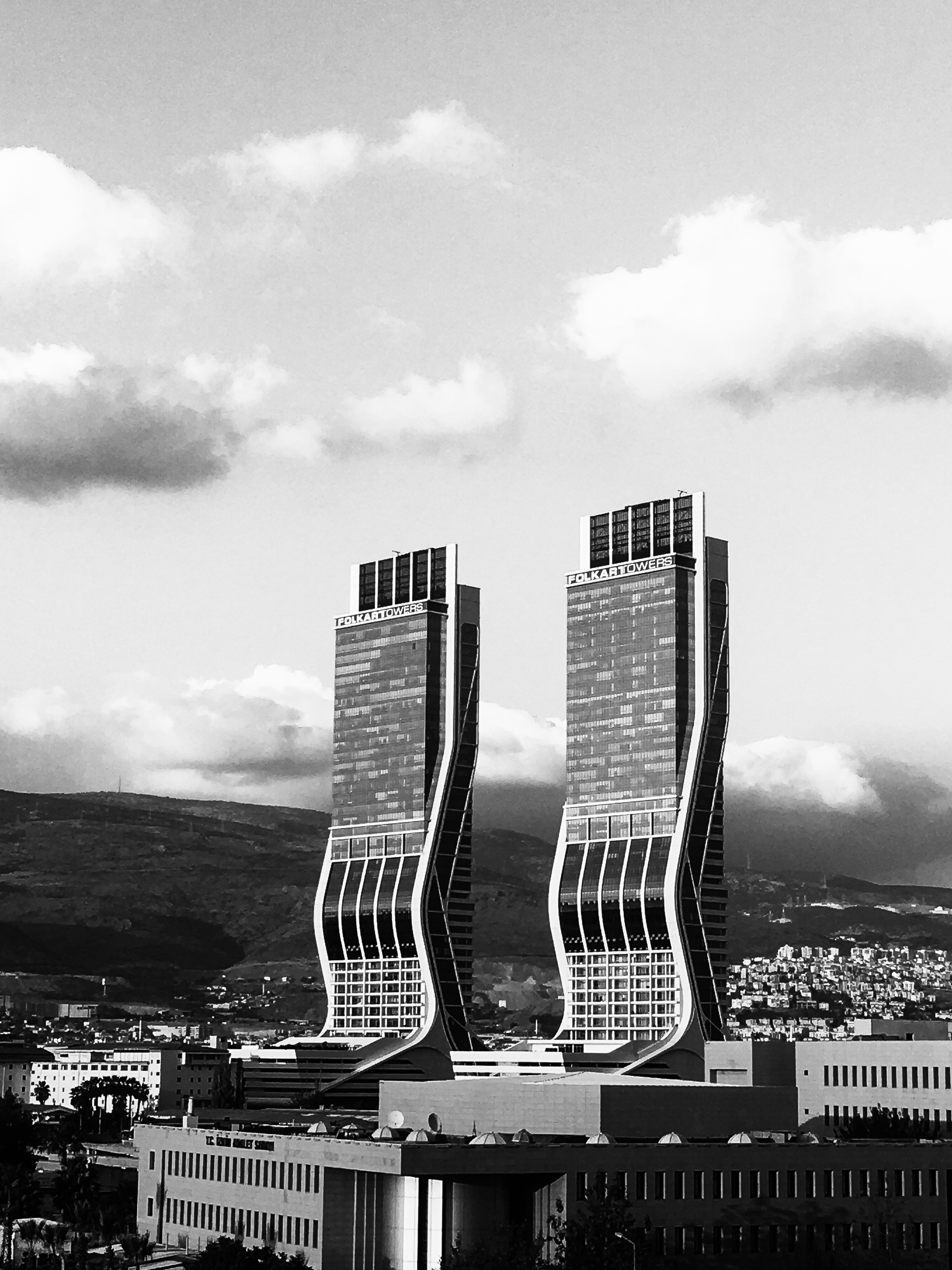Greyscale photography of two high rise buildings