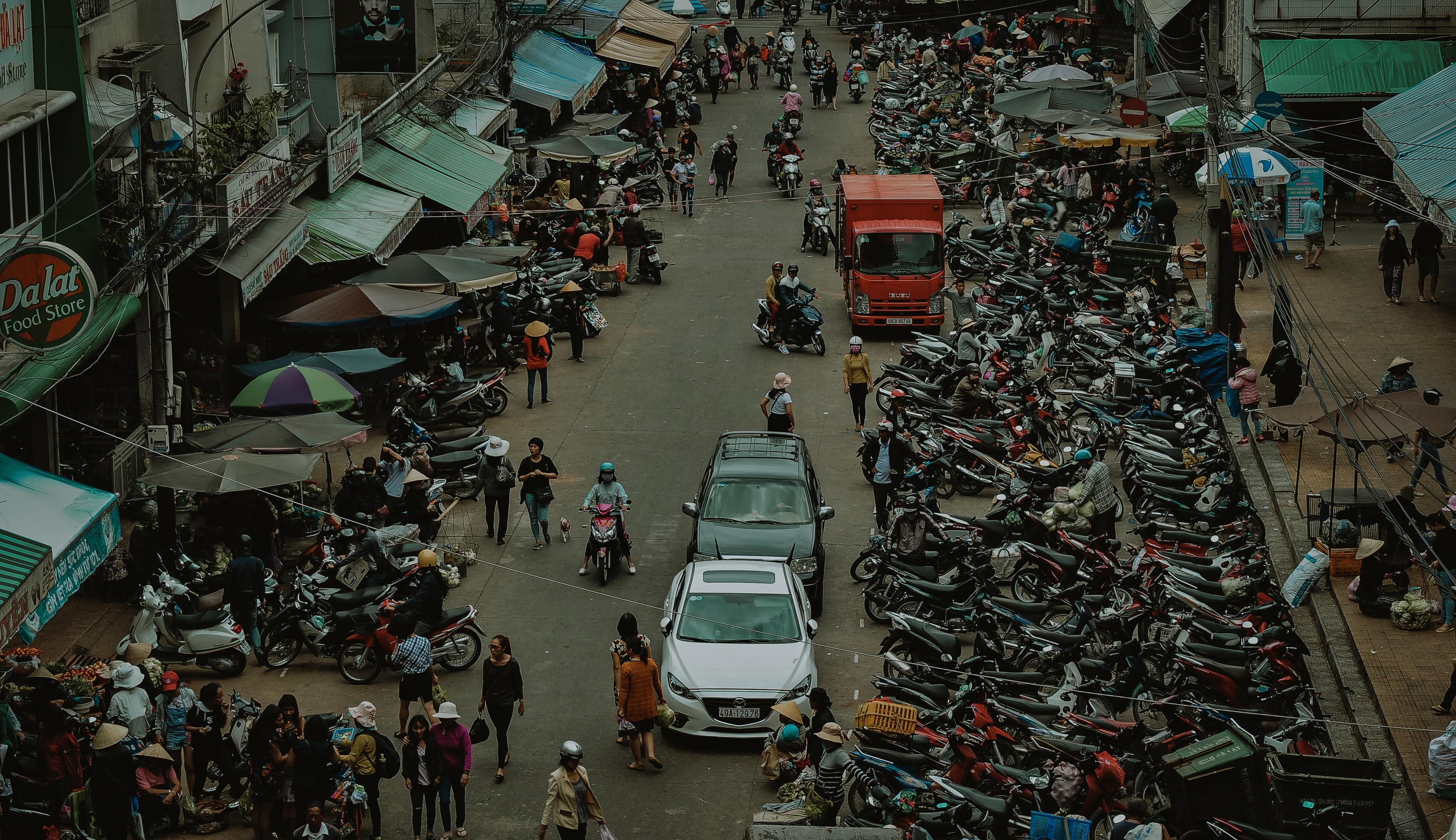 Group of people walking through market photo