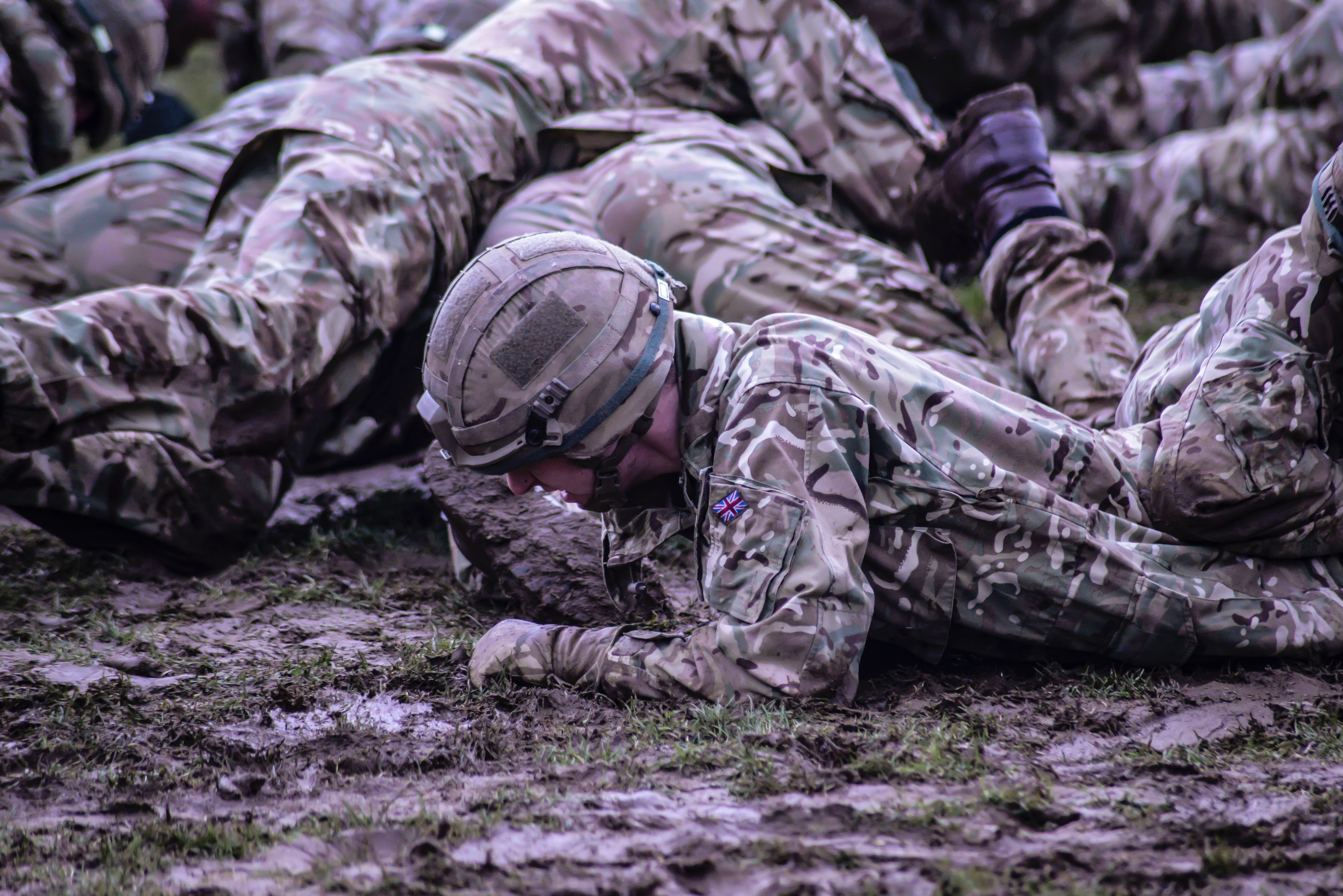 Group of soldiers crawling on mud photo