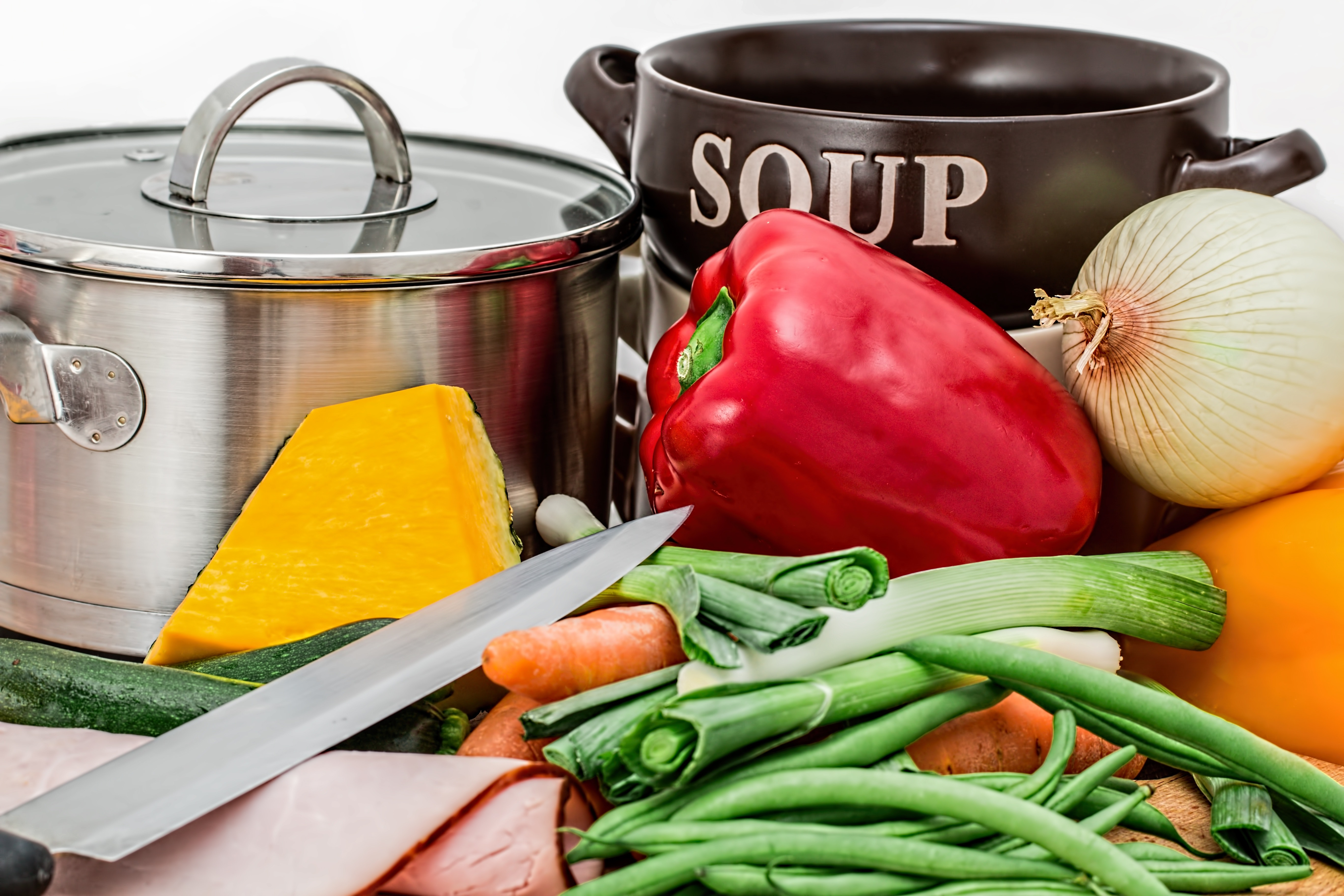 Group of vegetables near stainless steel cooking bowl photo