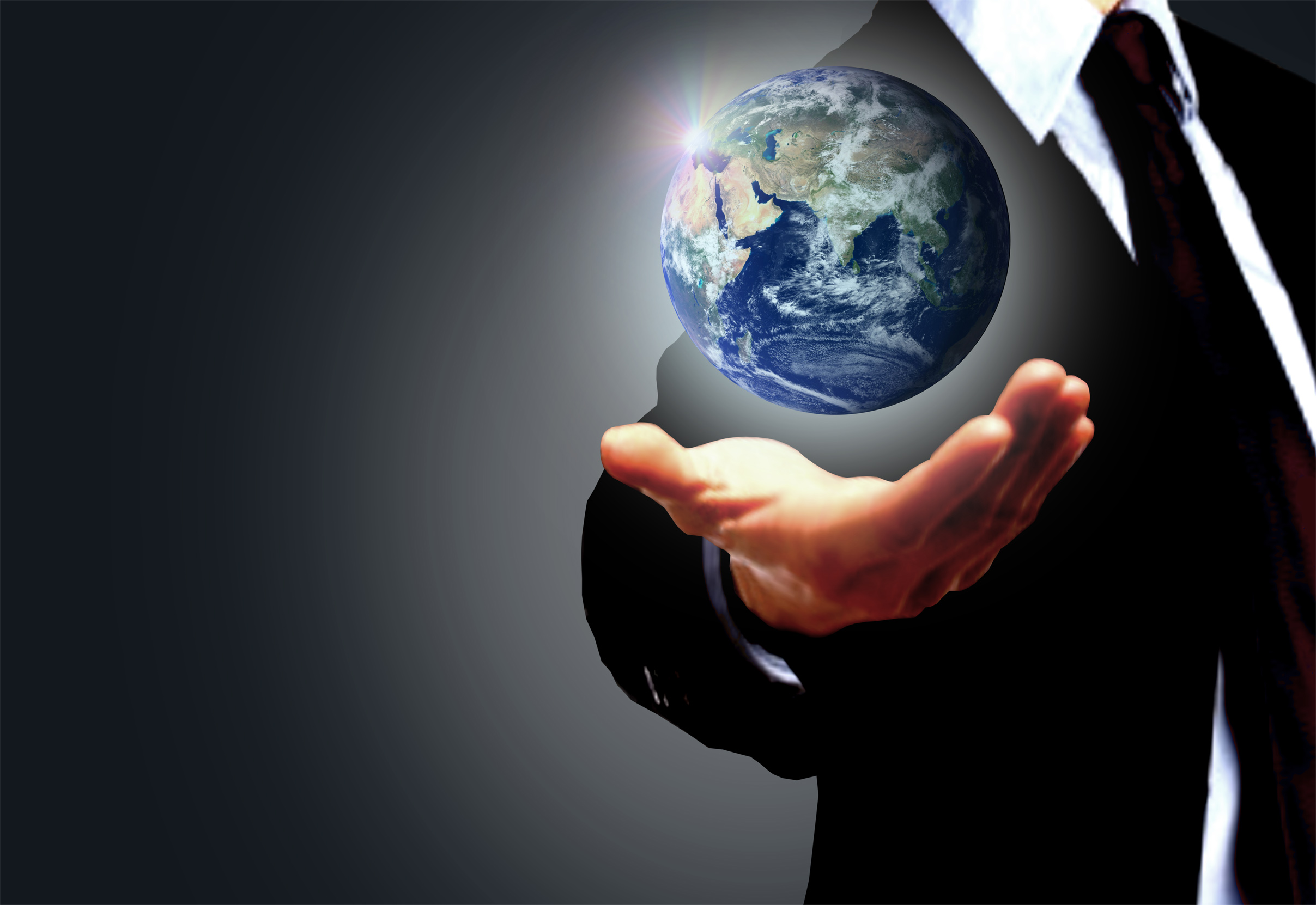 Hand of a businessman holding earth globe - globalization concept photo