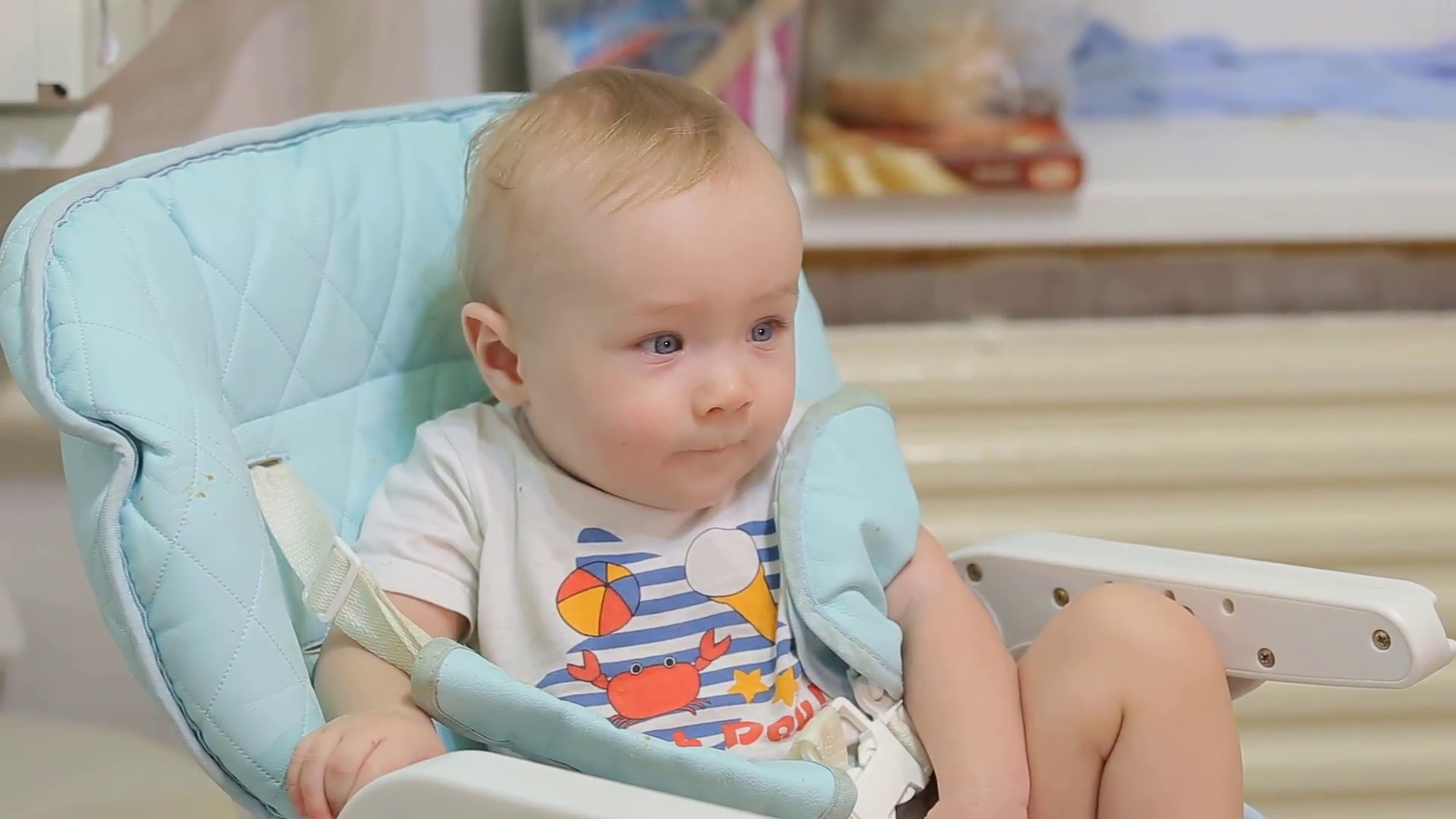 happy baby smiling on a chair Stock Video Footage - VideoBlocks