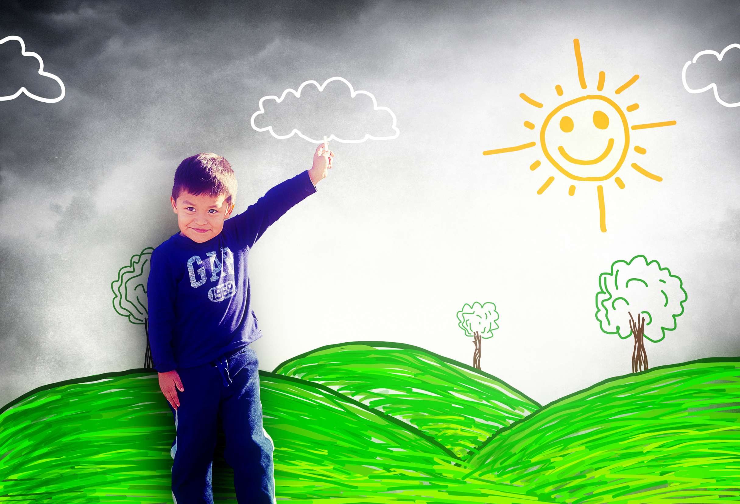 Happy child drawing a sunny landscape photo