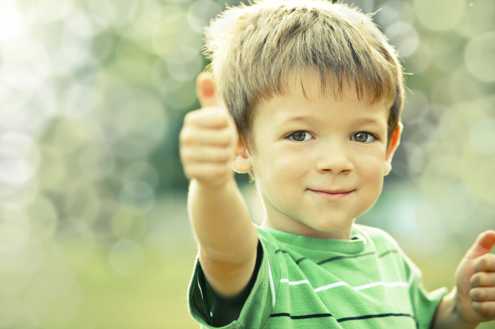 happy smiling kid outdoor doing OK portrait green tone | Dixie ...