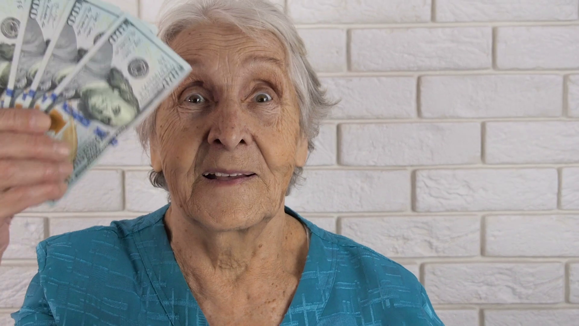 Happy old woman with money. An elderly woman is waving money. Stock ...