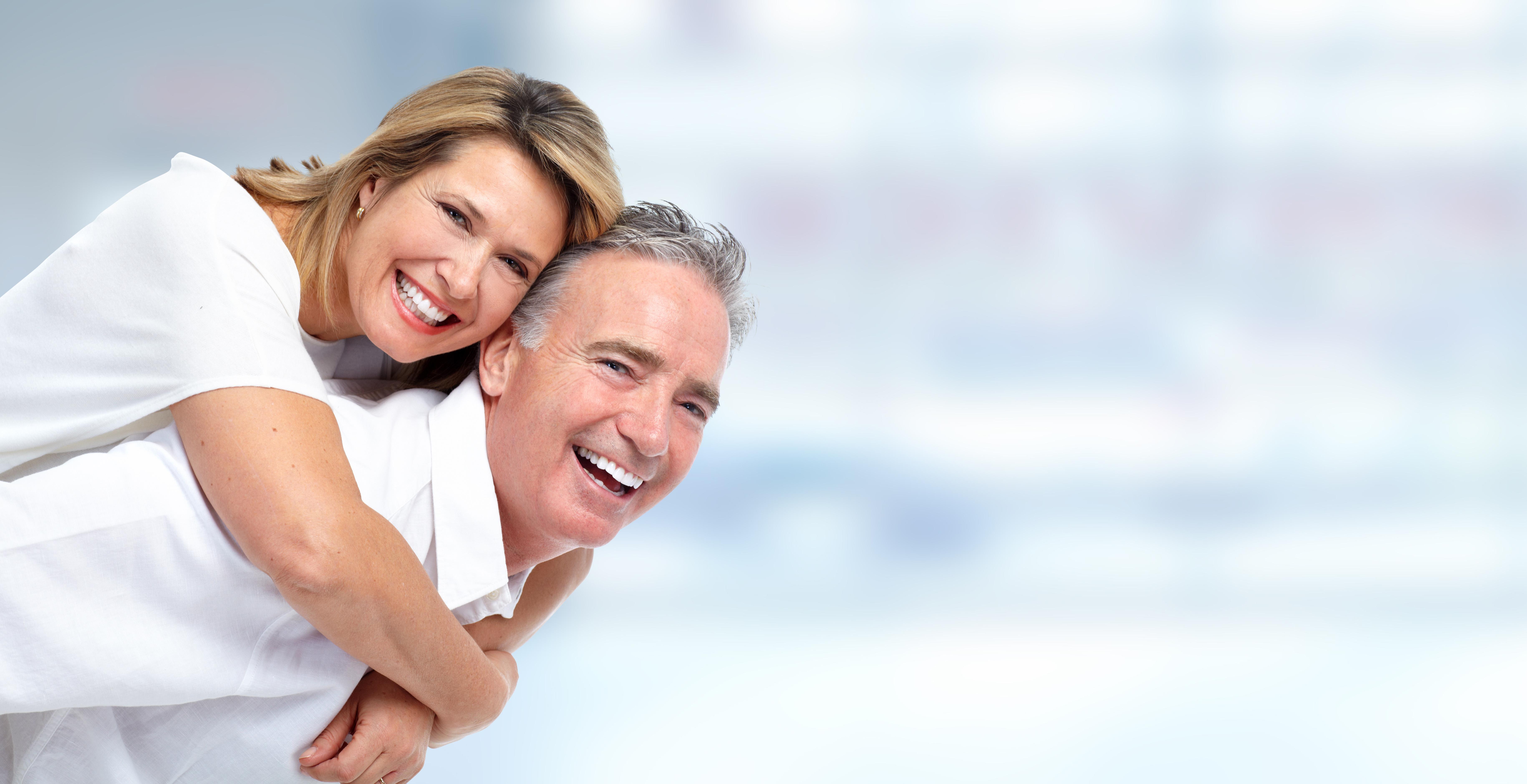 Happy senior couple portrait. - Winslow Dental