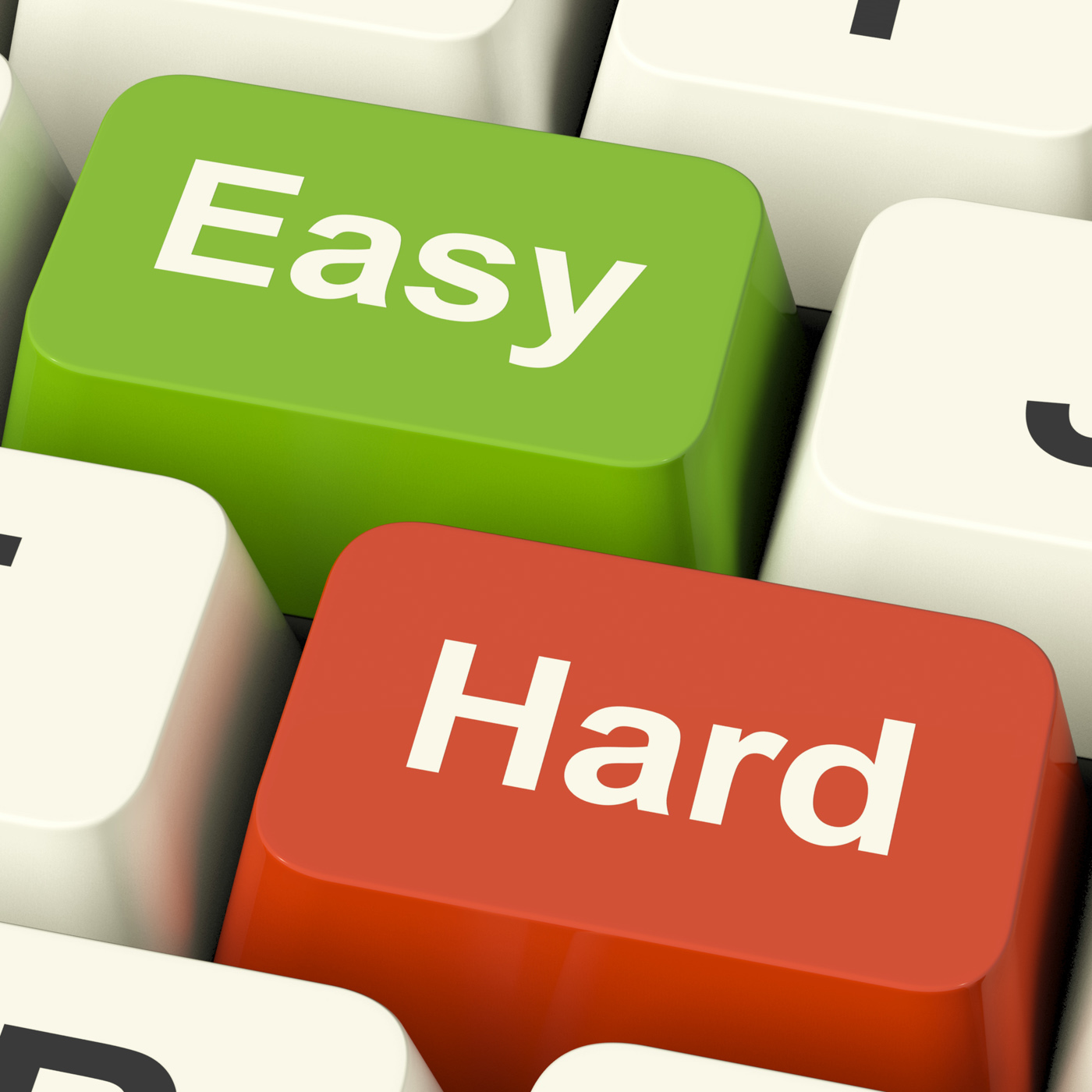 Hard easy computer keys showing the choice of difficult or simple way photo