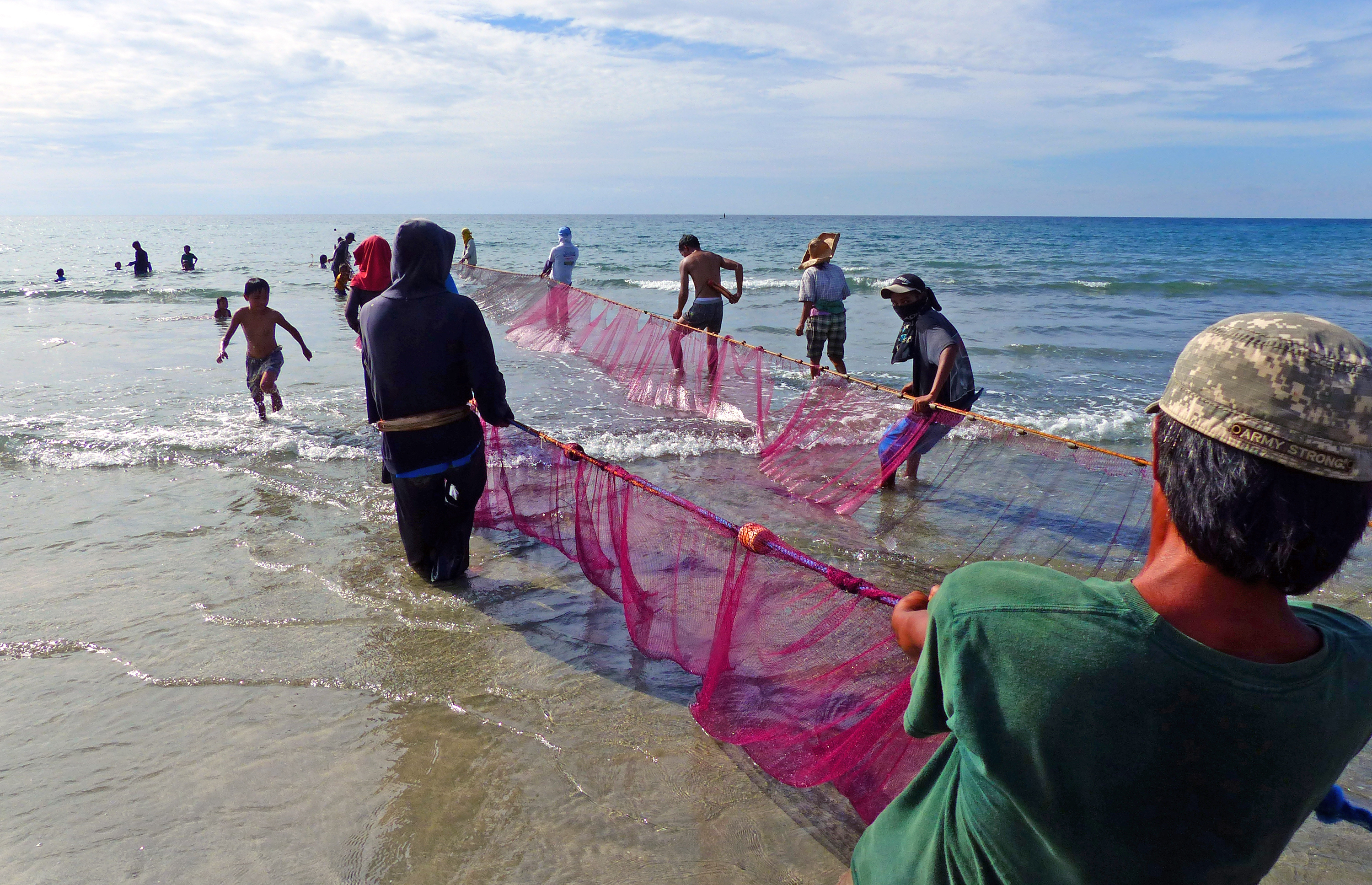 Hauling in the nets. philippines. photo