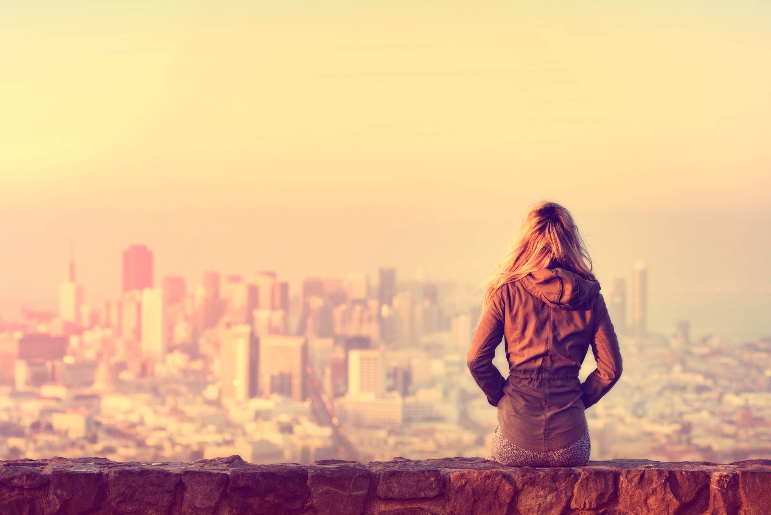 Hazy vintage looks - girl looking over the city photo