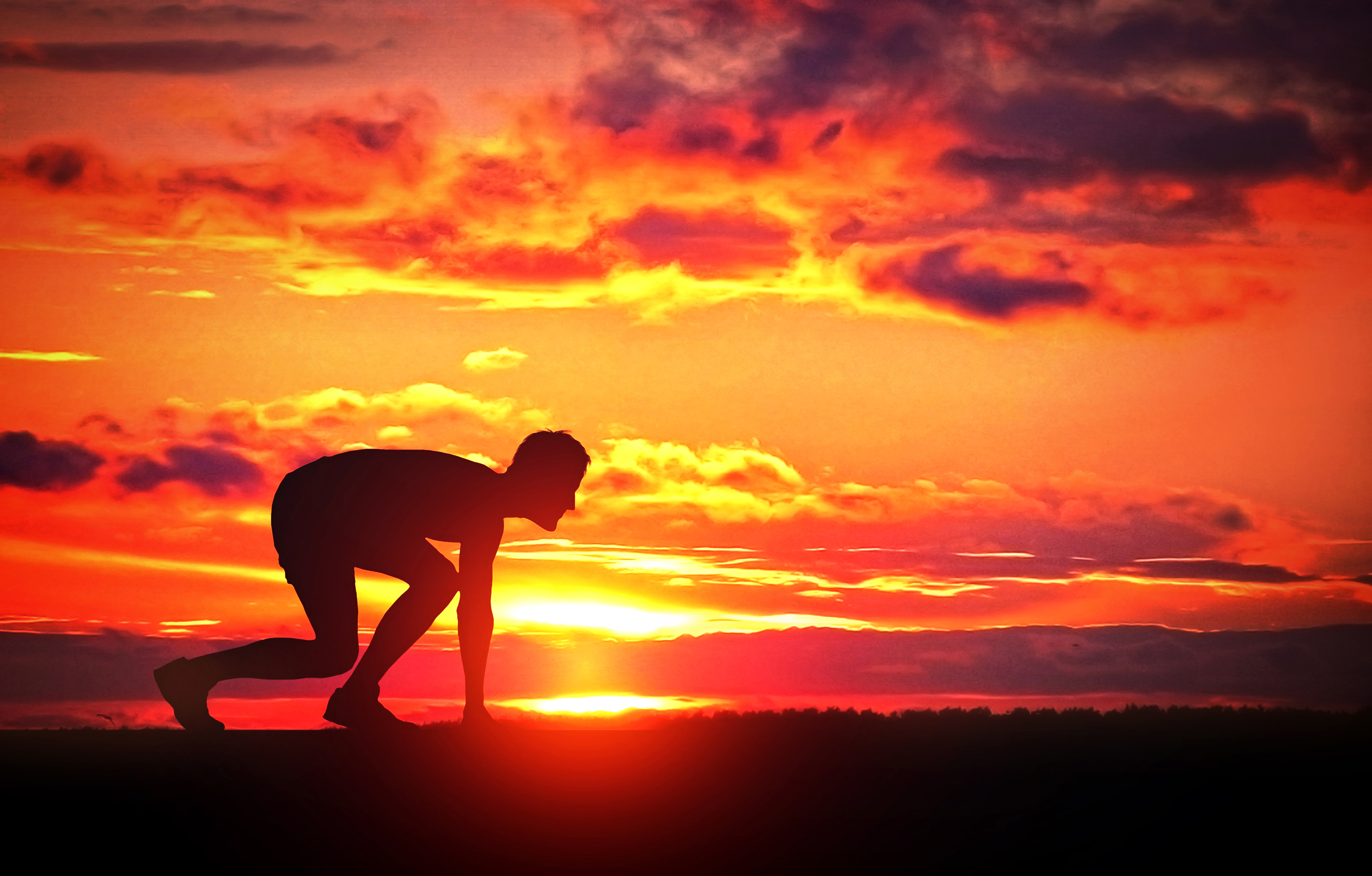 Healthy young runner at sunrise photo