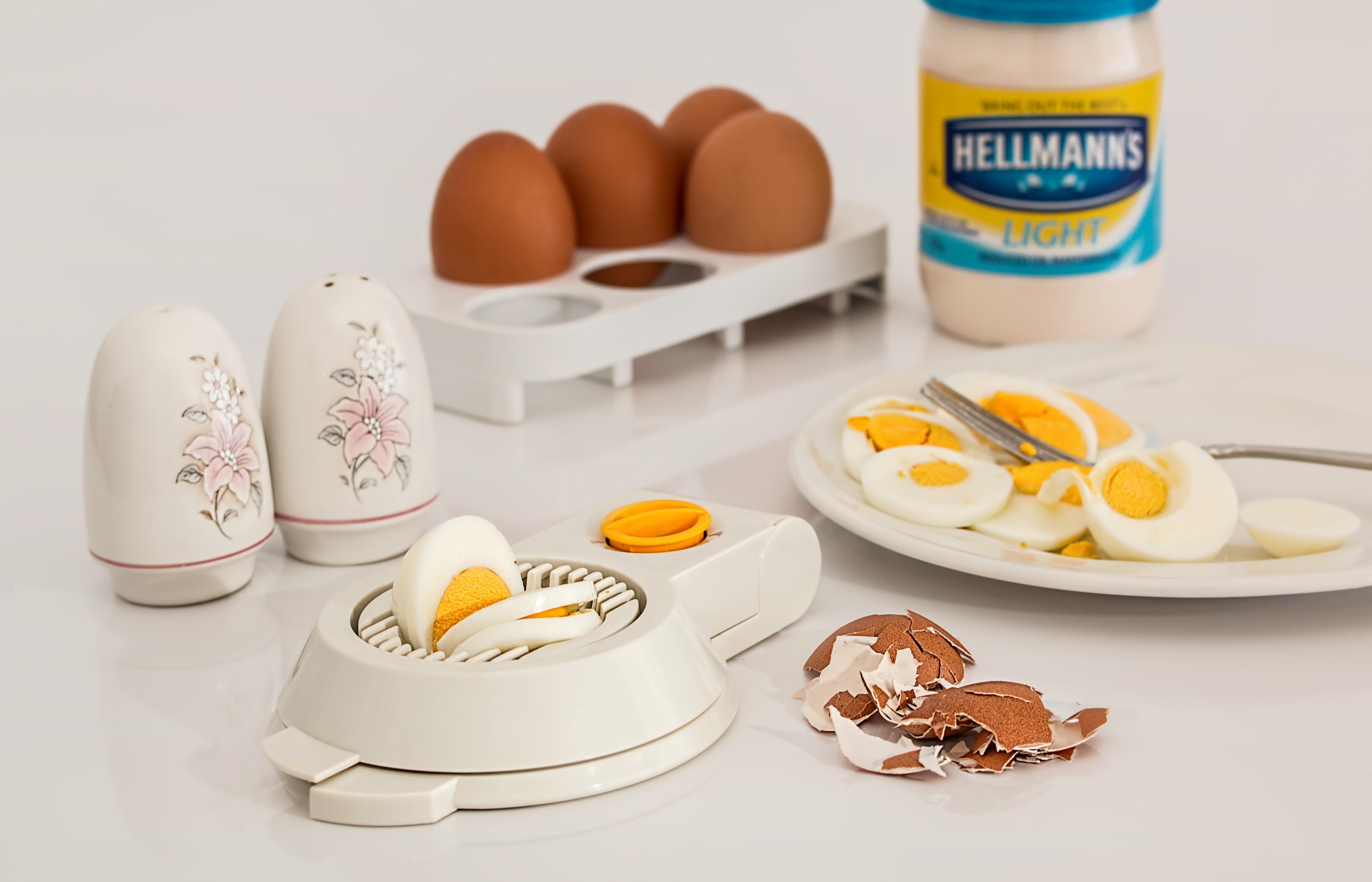 Hellmanks glass jar beside white egg rack photo