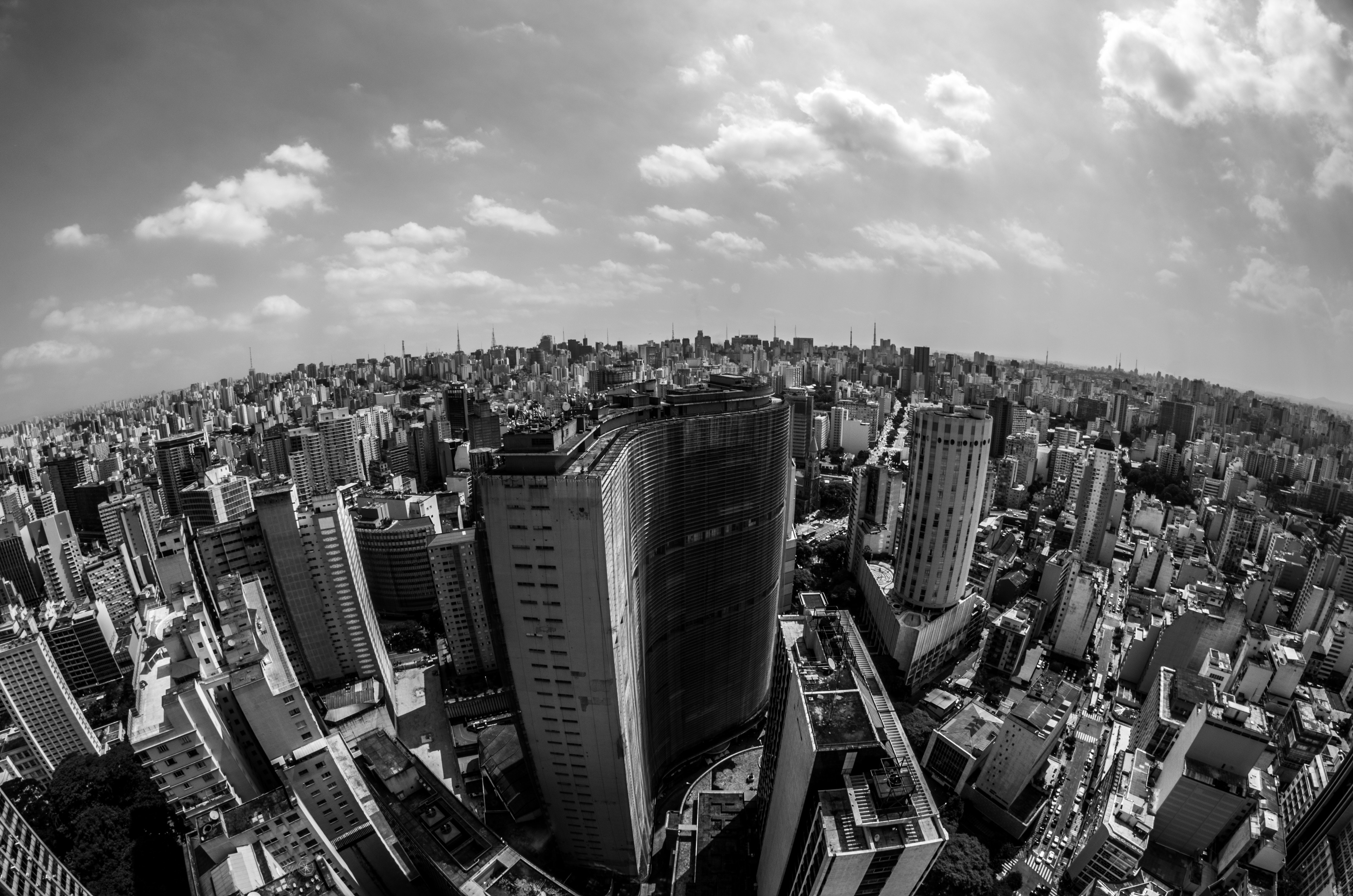 High angle view of cityscape against cloudy sky photo