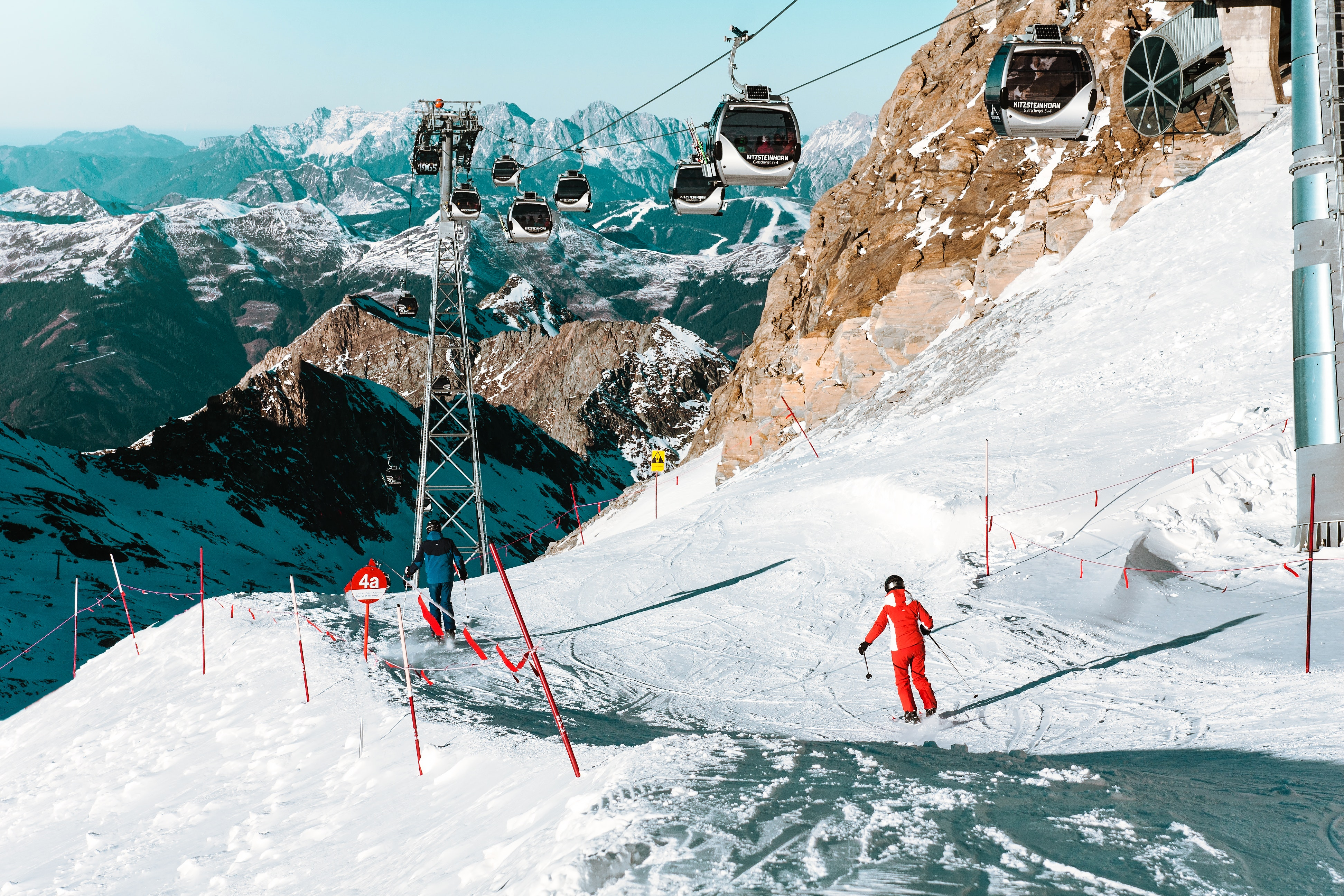 High angle view of people skiing on snowcapped mountain photo