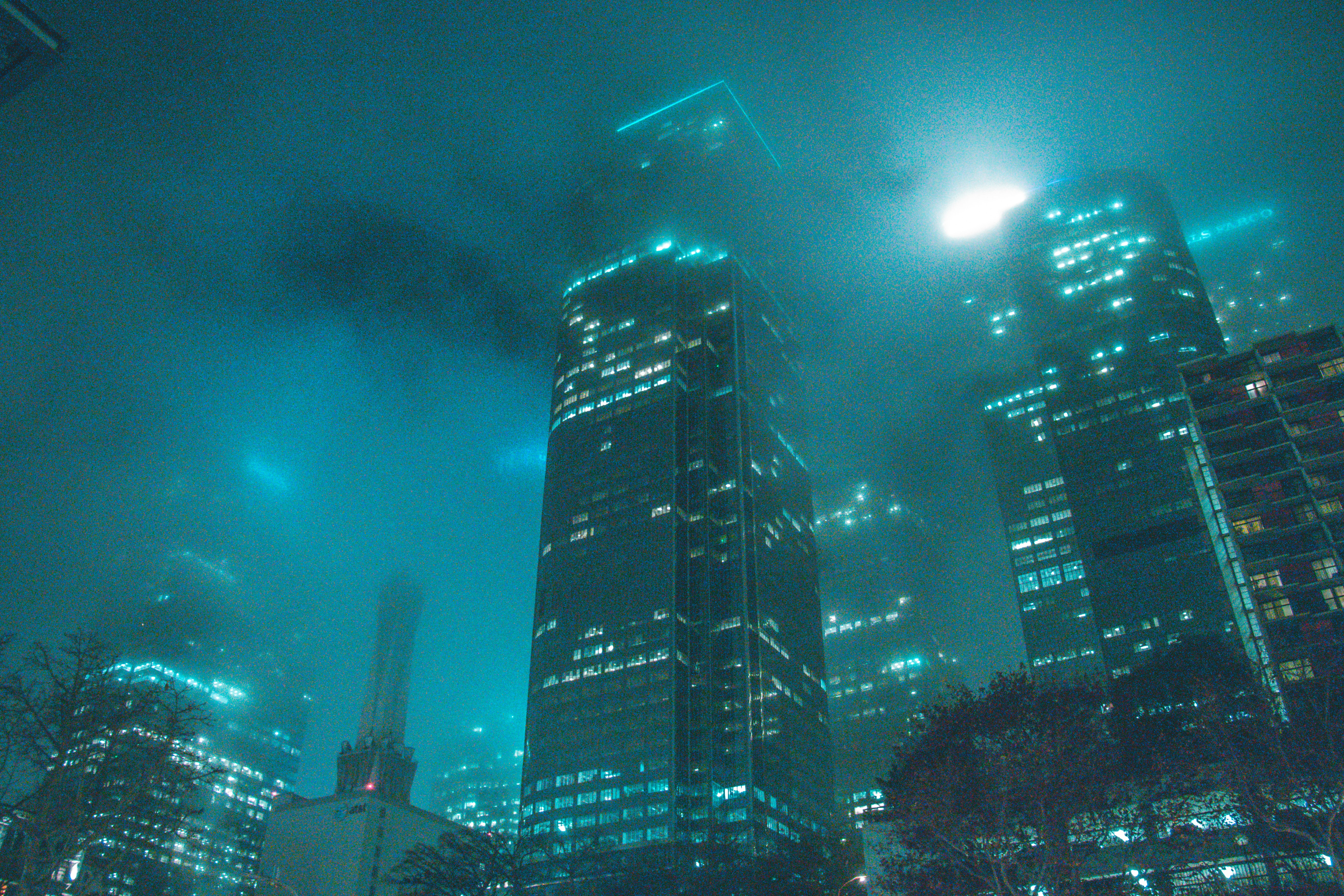 High-rise building beside buildings during night photo