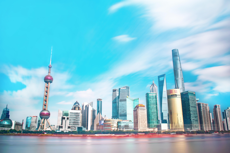 High rise buildings under blue sky photo
