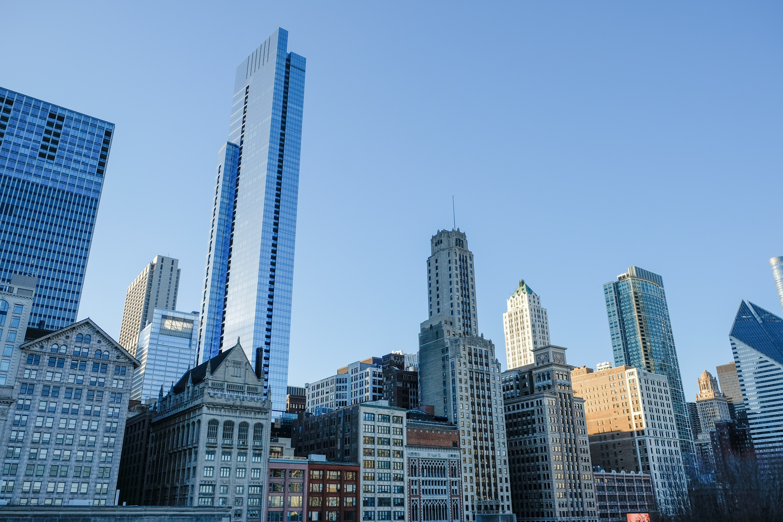 High-rise buildings under clear blue sky photo