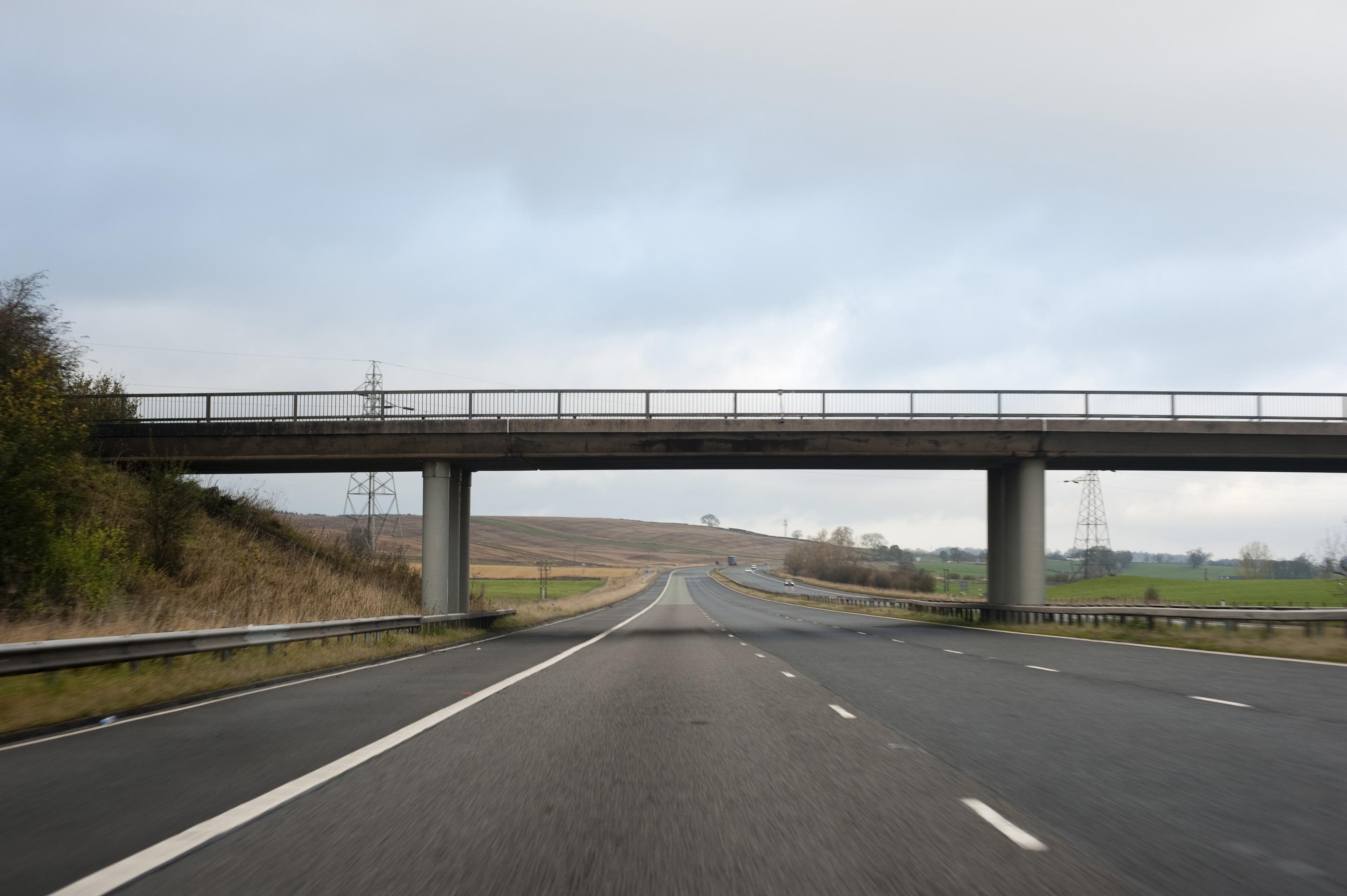 Image of Bridge over a multi lane highway | Freebie.Photography