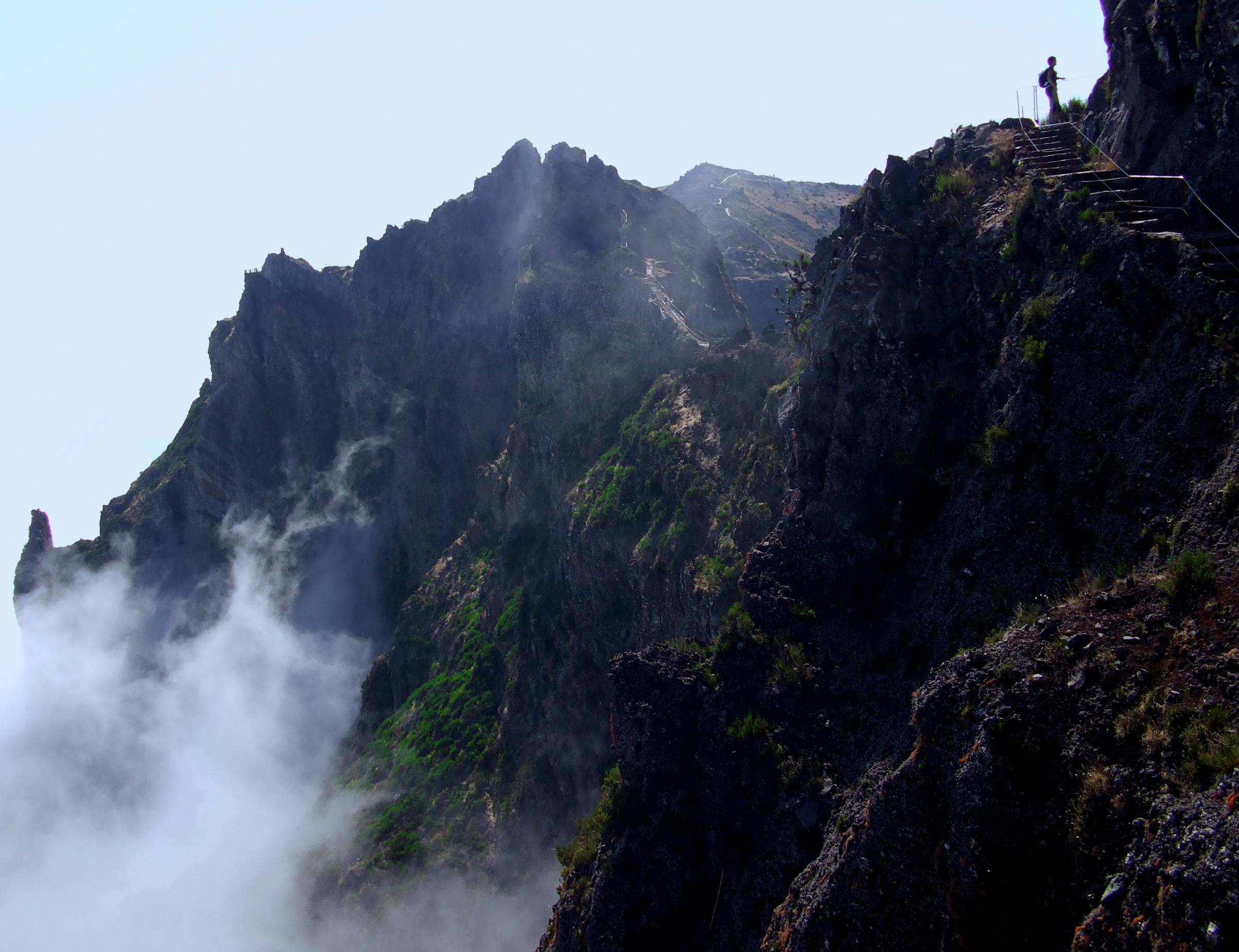 Hiker silhouette near the precipice photo