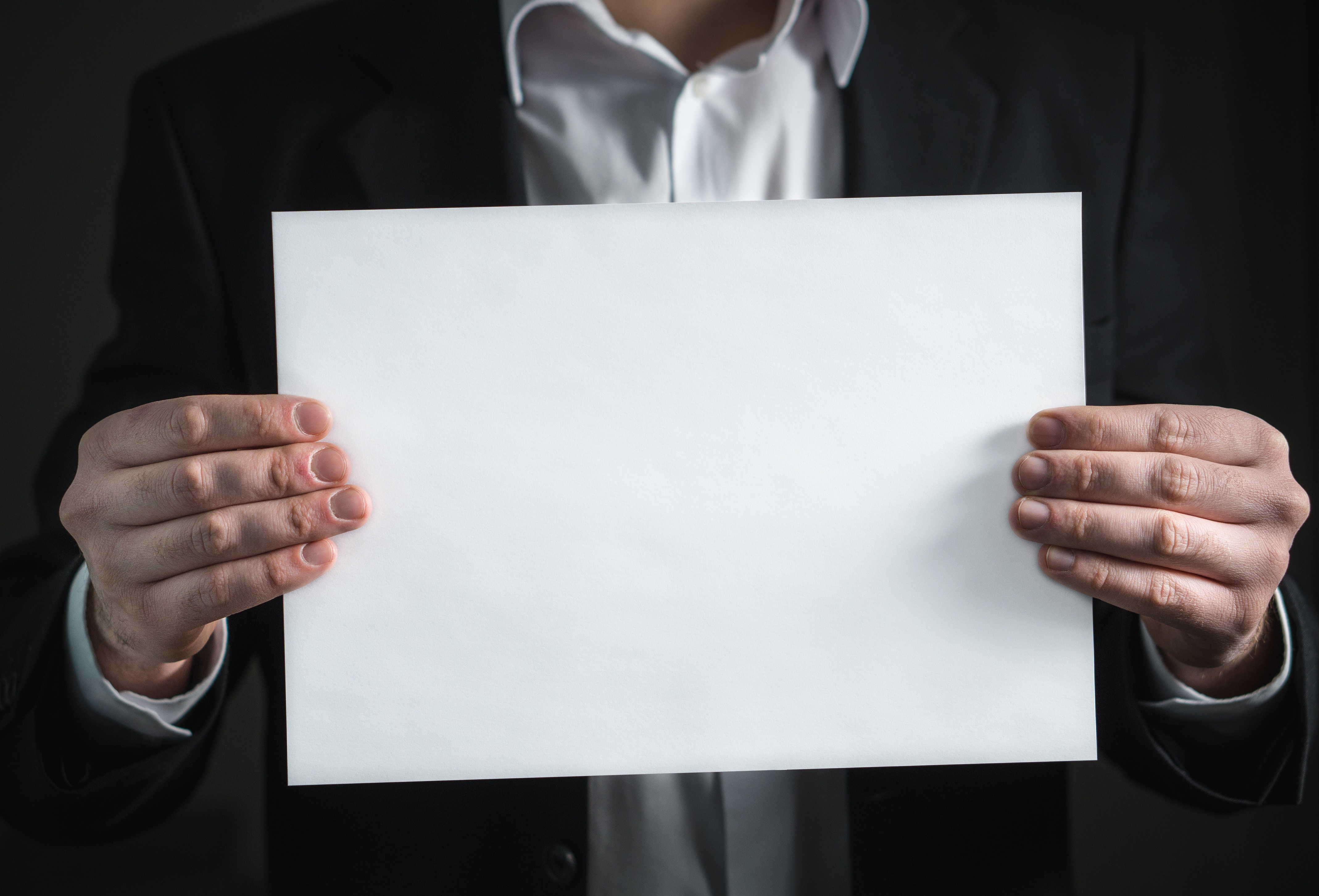 Holding a paper photo