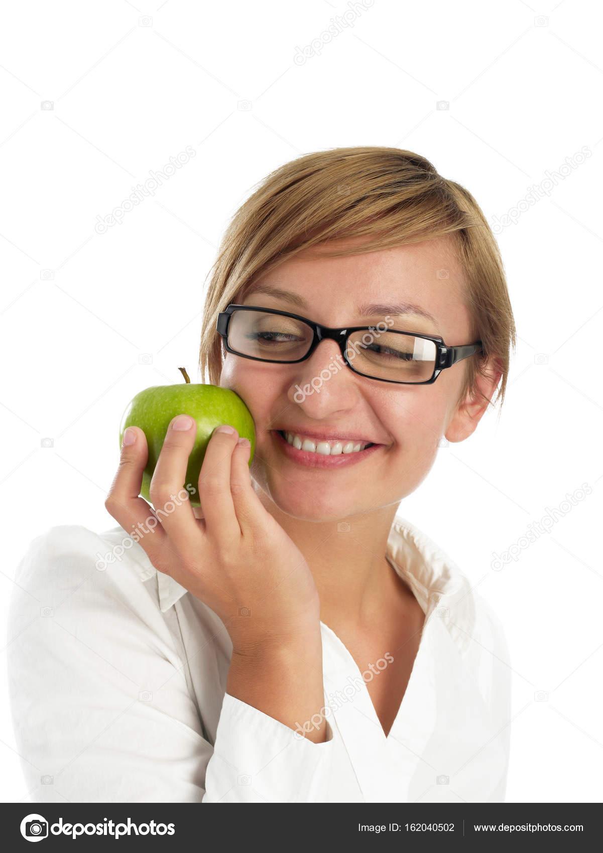 Cheerful woman holding an apple — Stock Photo © Goir #162040502