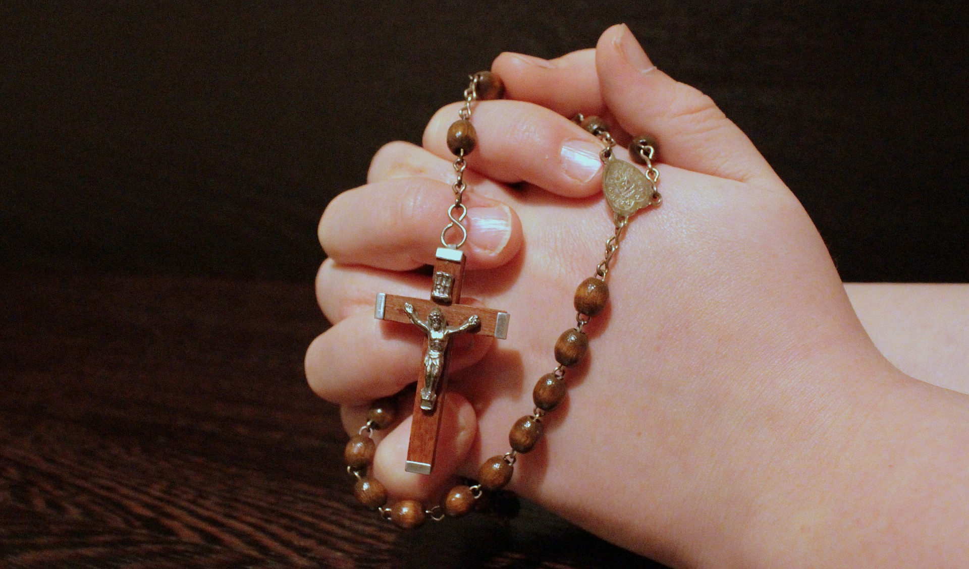 Holding string of beads, praying to god photo