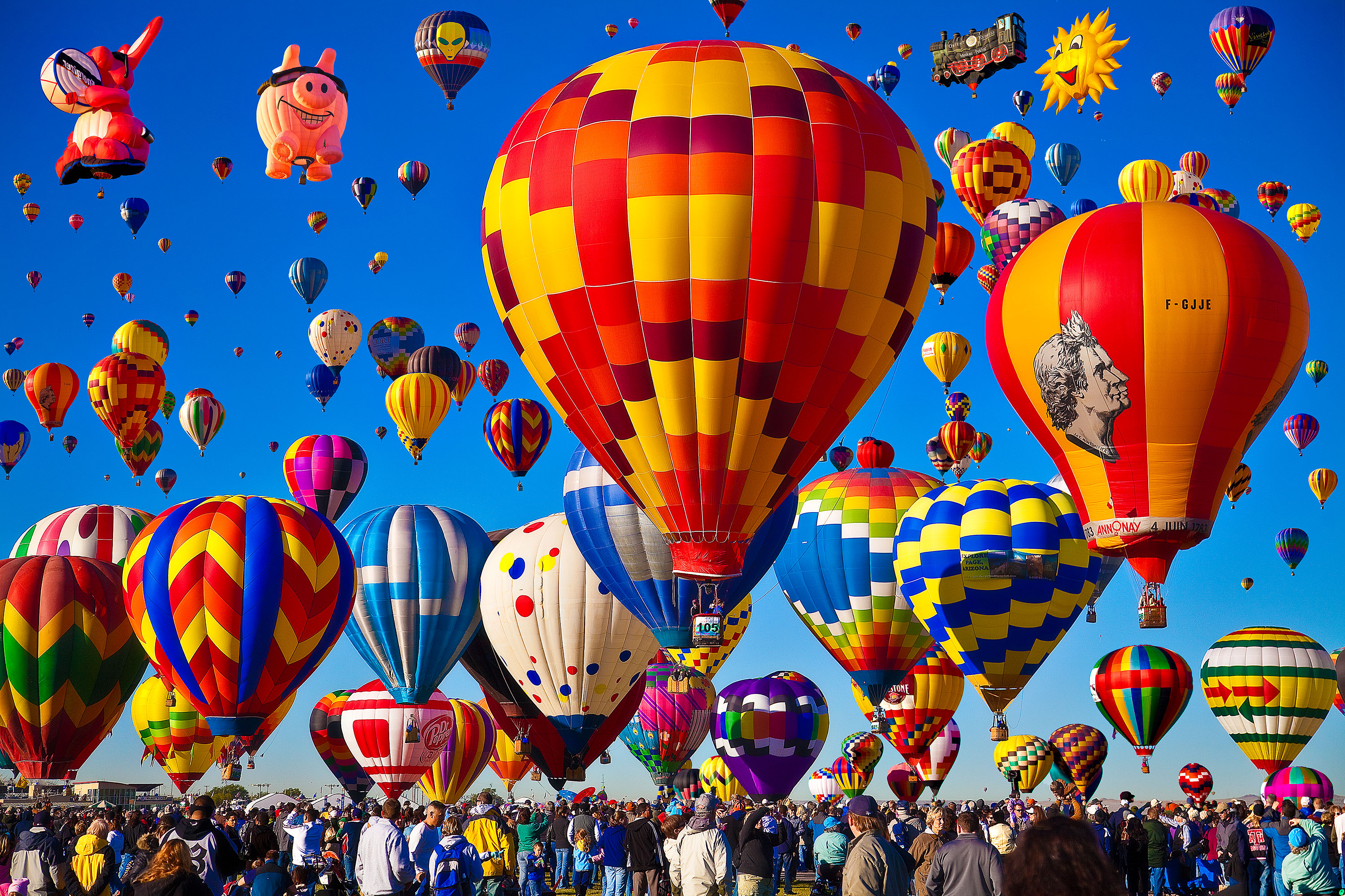 Watch Hundreds of Colorful Hot-Air Balloons Fill the Sky