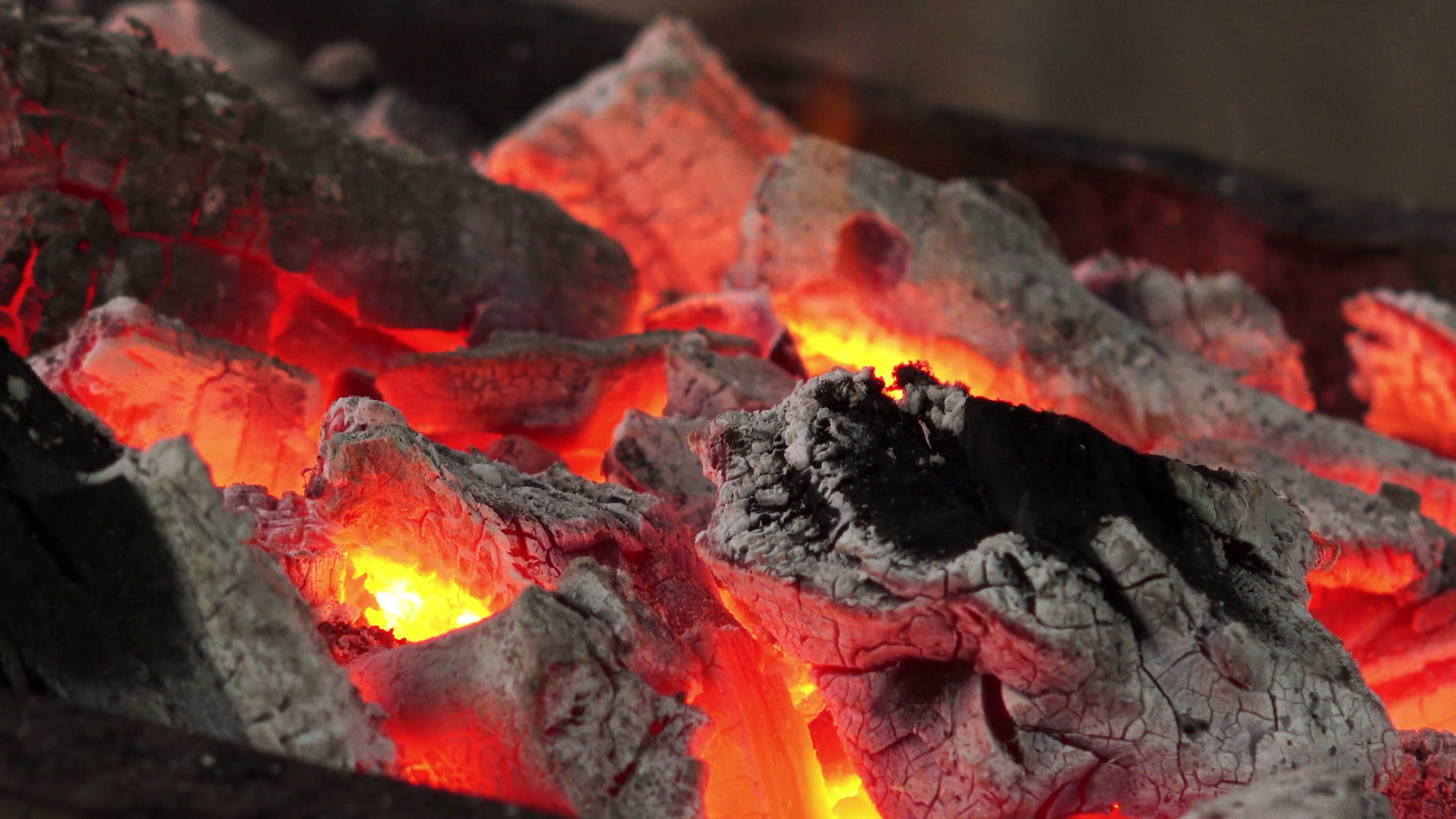 Firewood and hot coal in a grill, fire burning for the meat cooked ...