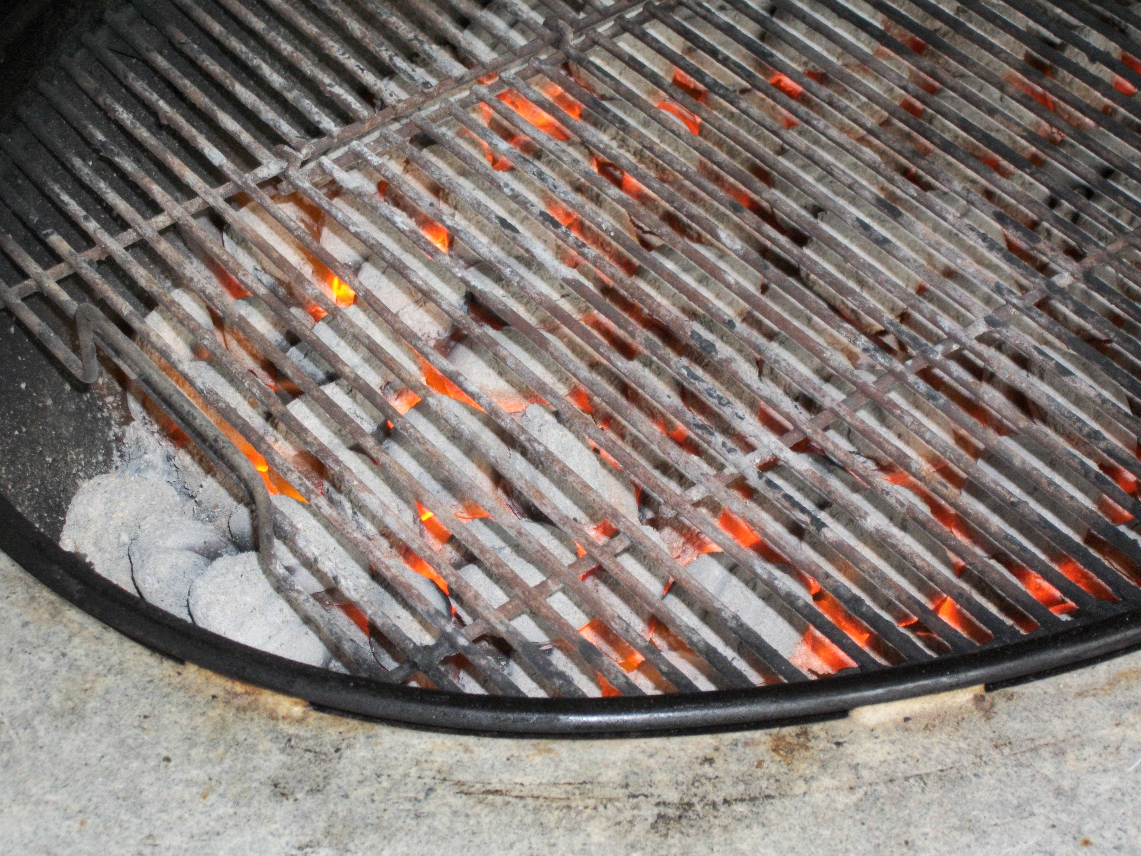 Hot coals in grill photo