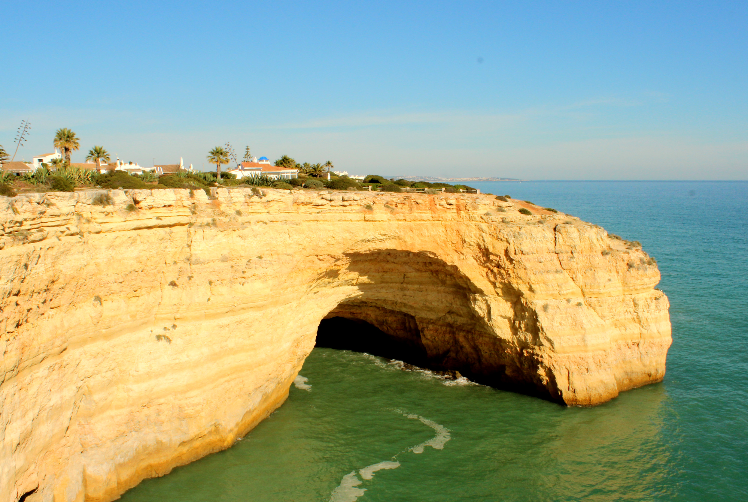 Houses atop a huge cliff in algarve photo