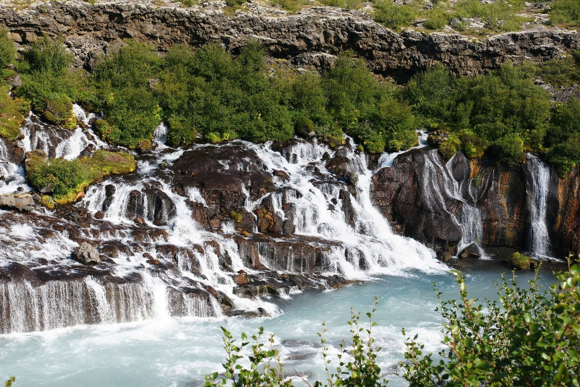 Hraunfossar is one of the most unusual #waterfalls in #Iceland. It ...