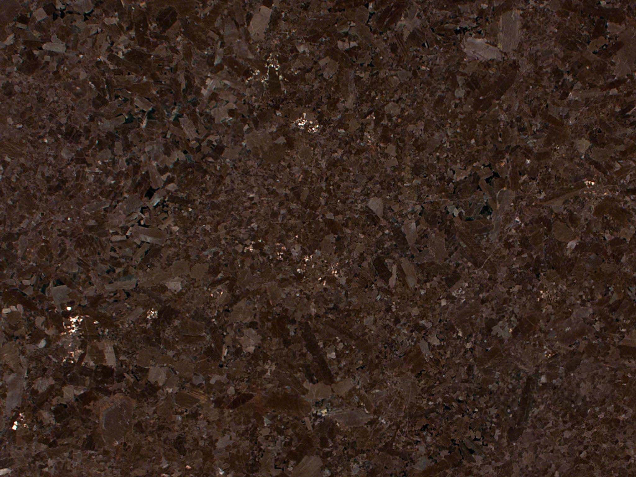 Brown antique granite highlight natural variations in stone with its ...