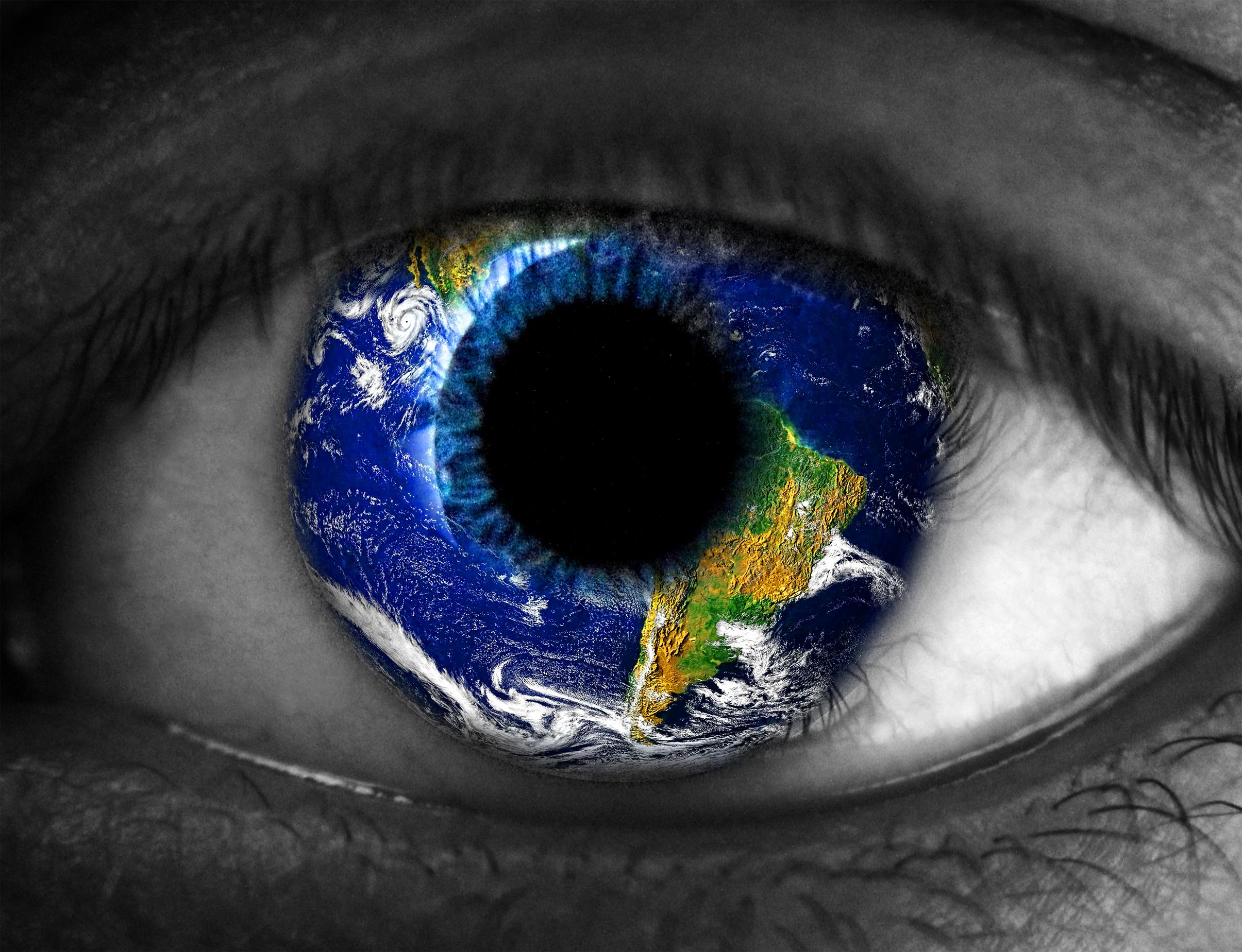 Human eye with planet earth photo