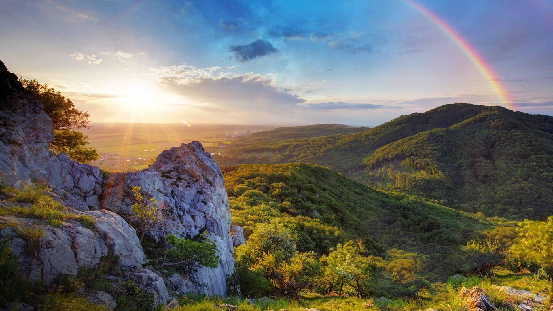 Green mountain sunset with sun and rainbow, Iceland | Windows 10 ...