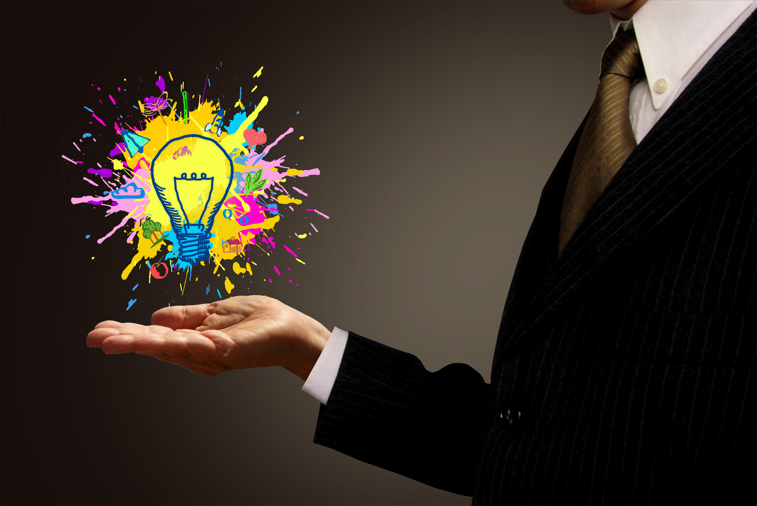 Ideas at hand - businessman and painted lightbulb photo
