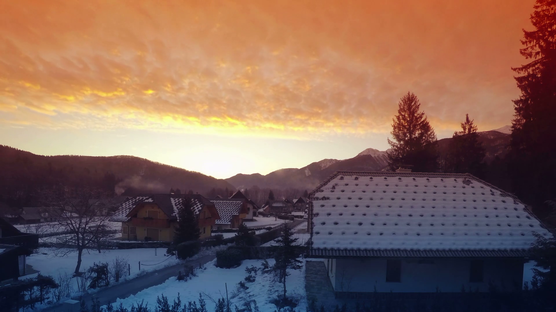 Winter morning sunrise in mountain village, time lapse footage of ...