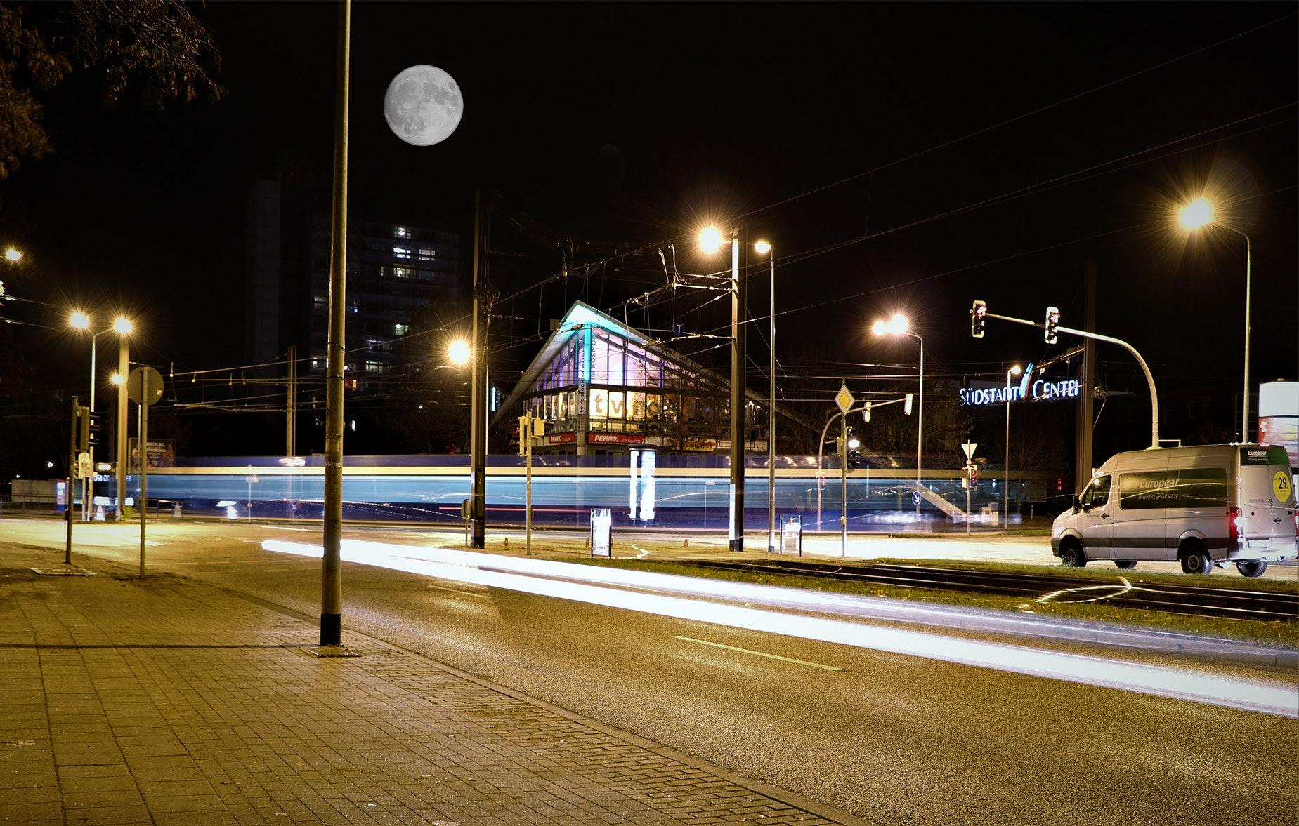 Illuminated street lights at night photo