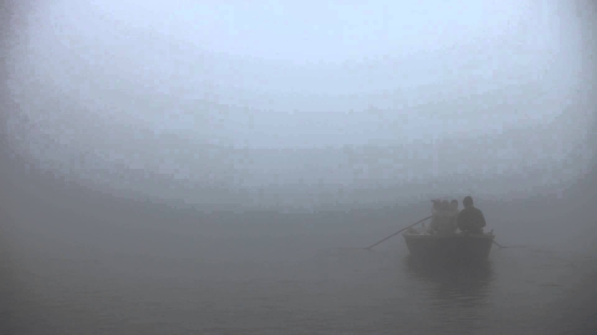 Boat disappearing into the fog in the Ganges: Varanasi, India ...