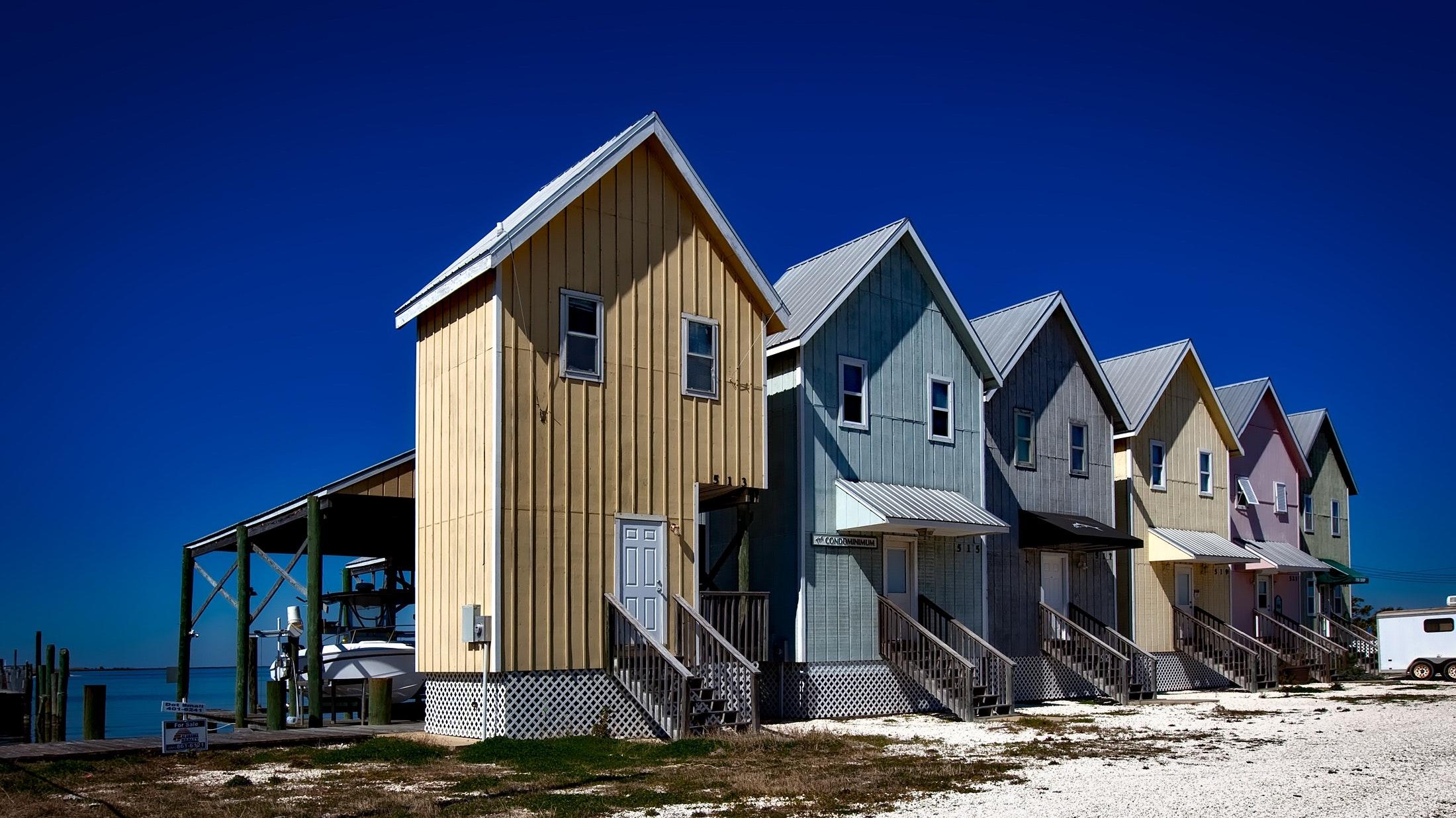 Inline house near seashore during daytime photo