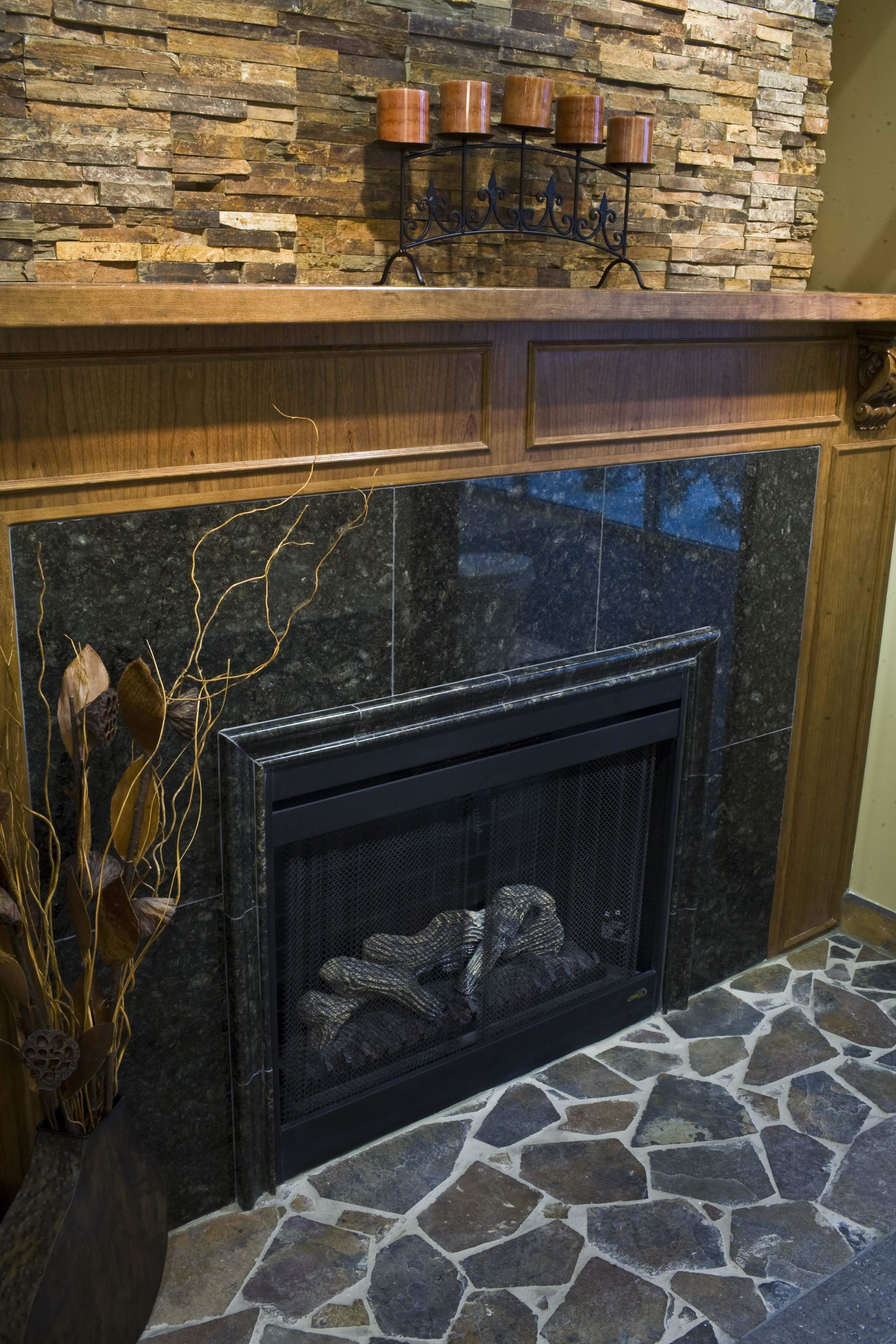 Granite and Travertine Fireplace. I like the stone above the fire ...